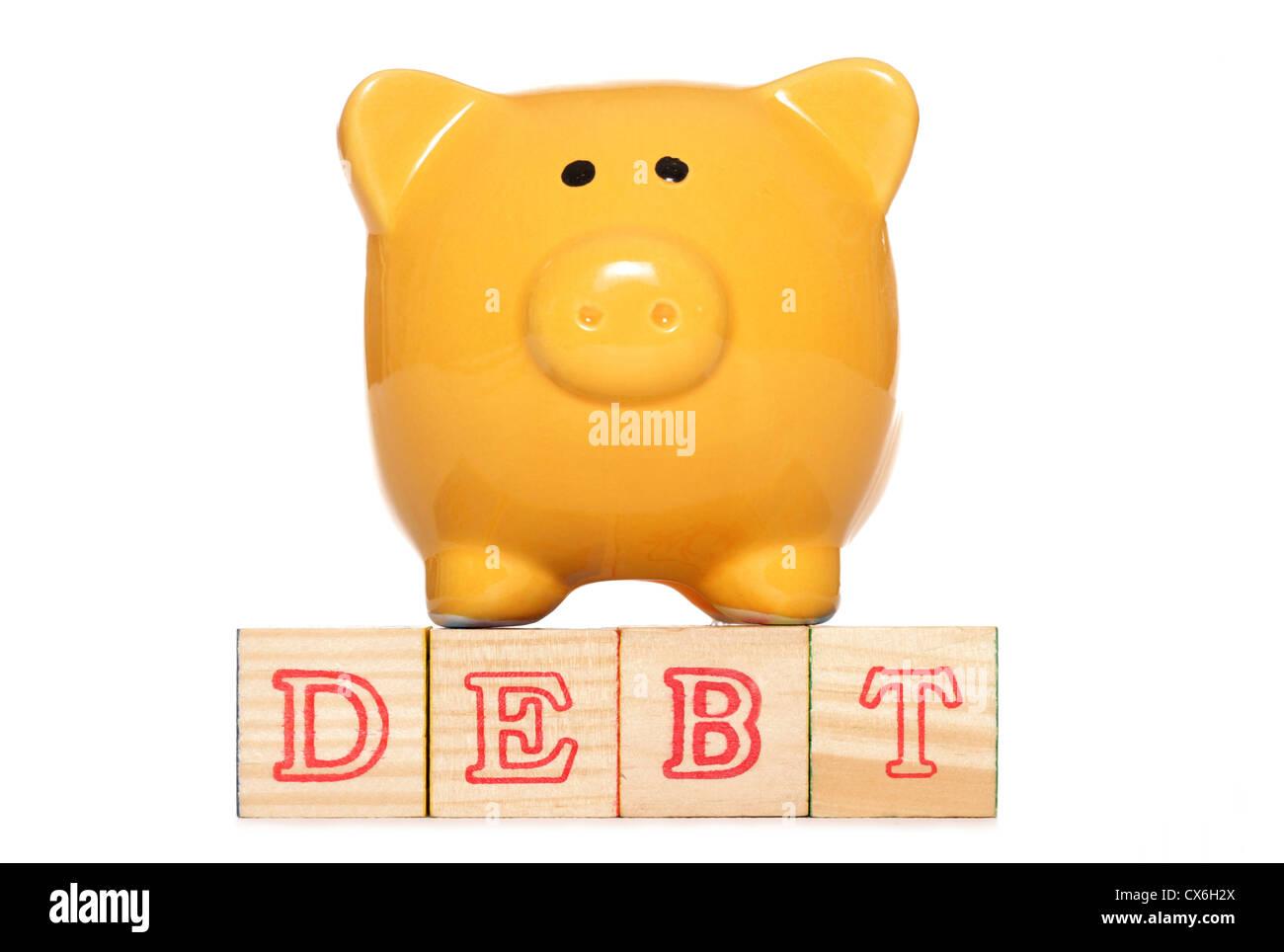 Piggy bank with debt text studio cutout - Stock Image