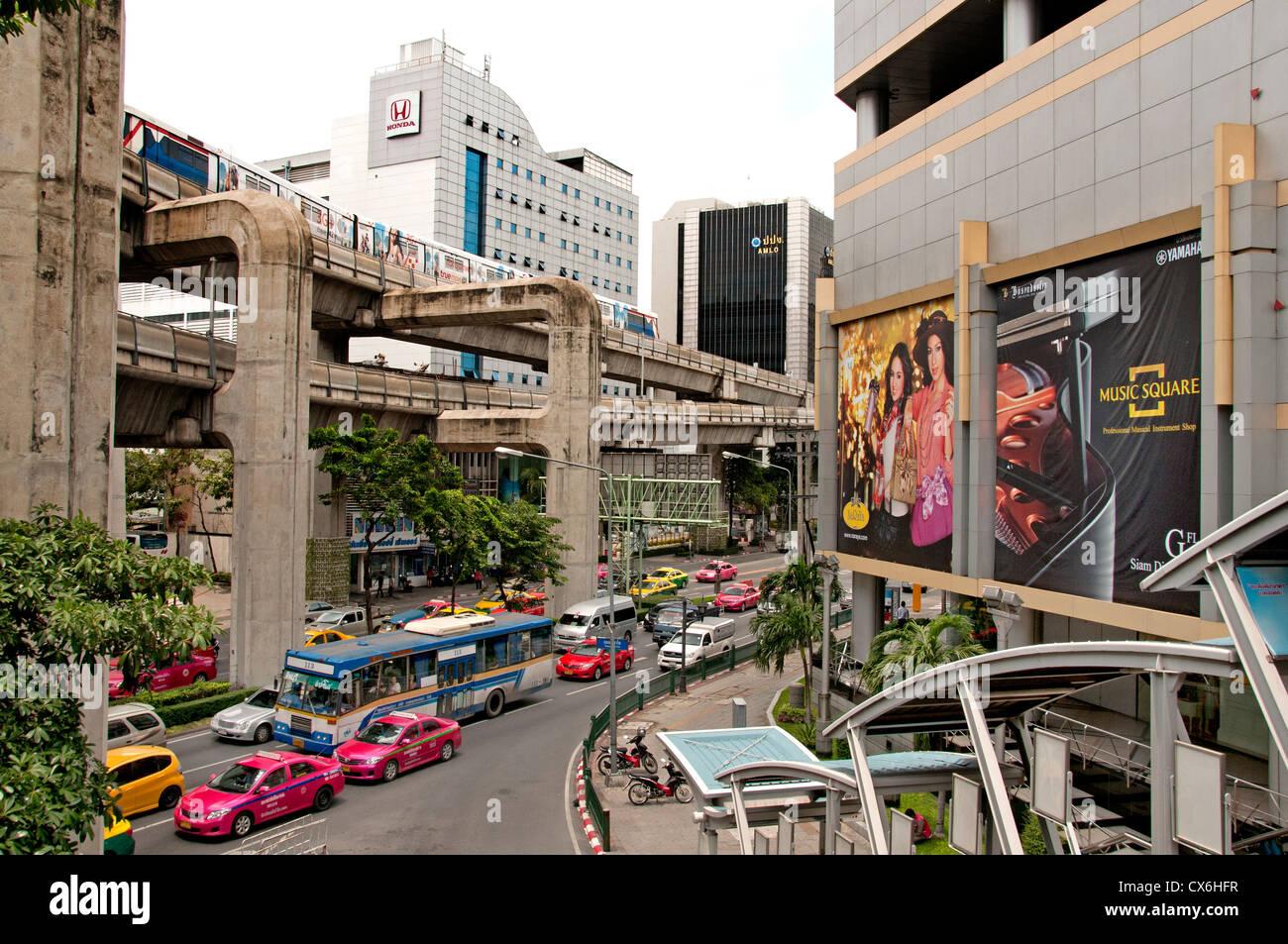 Skytrain crosses Pathumwan Siam Square district Center Bangkok Thailand Thai - Stock Image