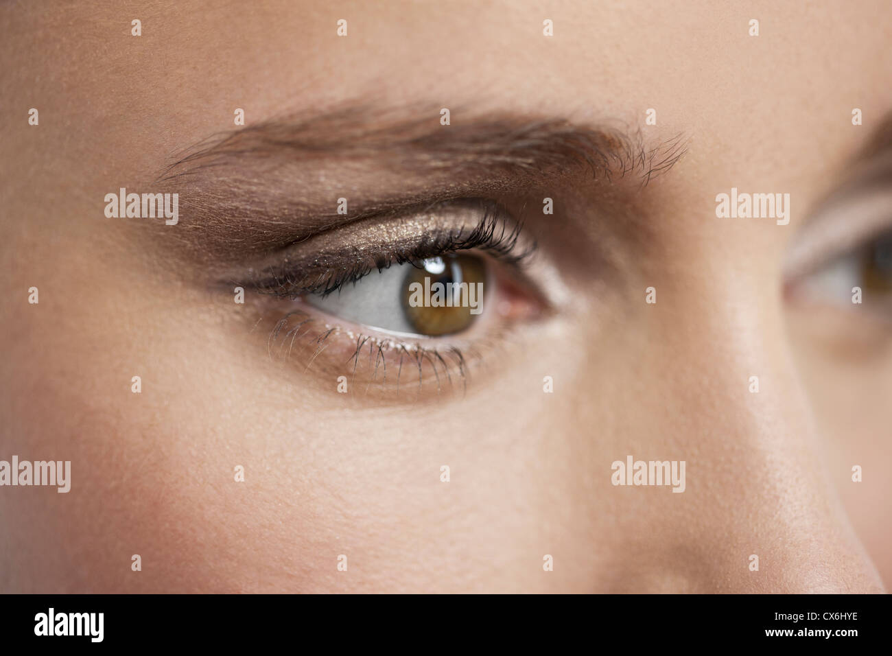 Close up of a young womans eye and eyelashes - Stock Image