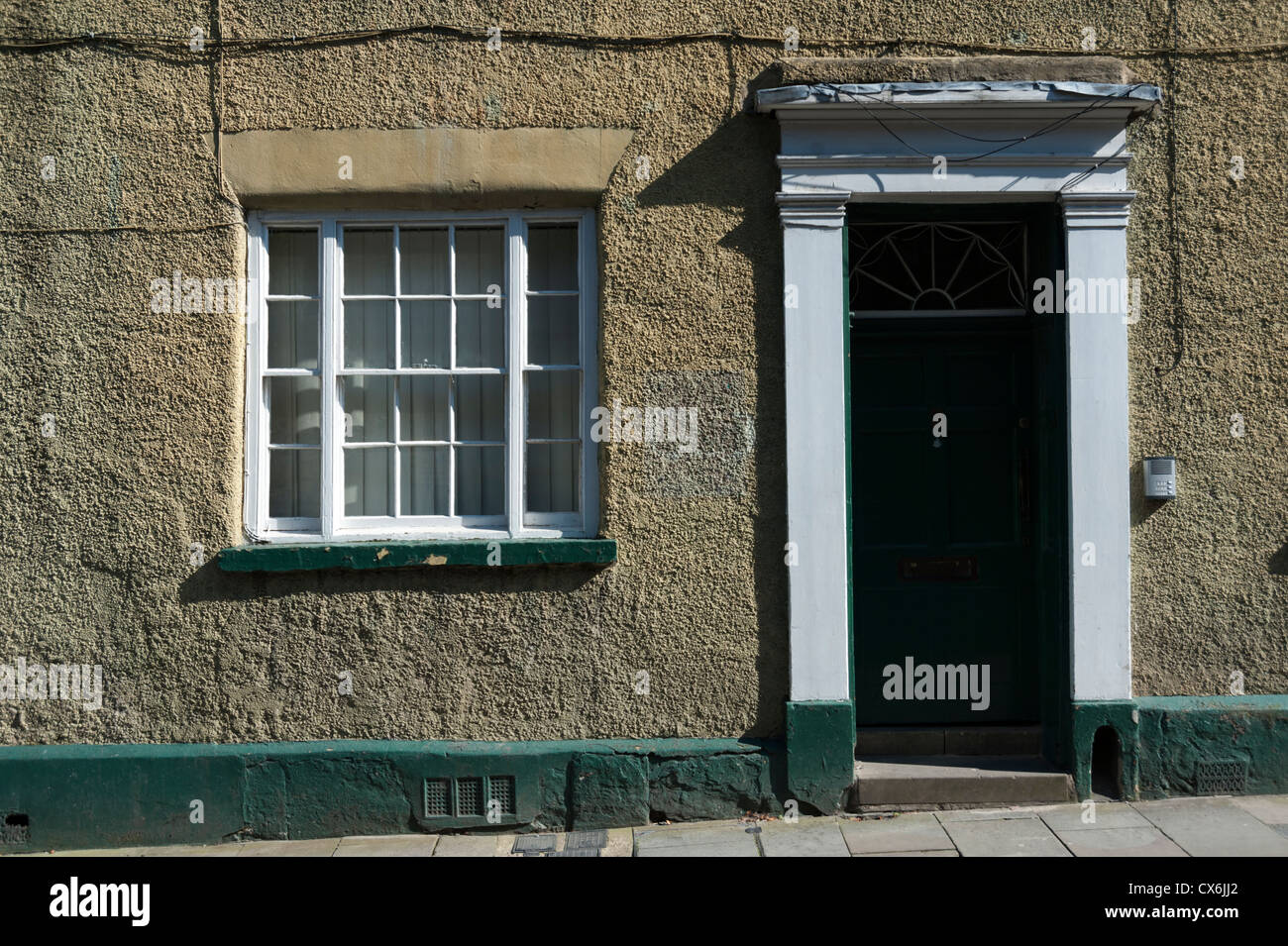 Old Georgian house in North Bailey Street in the city of Durham UK, with strong sidelight showing building texture - Stock Image