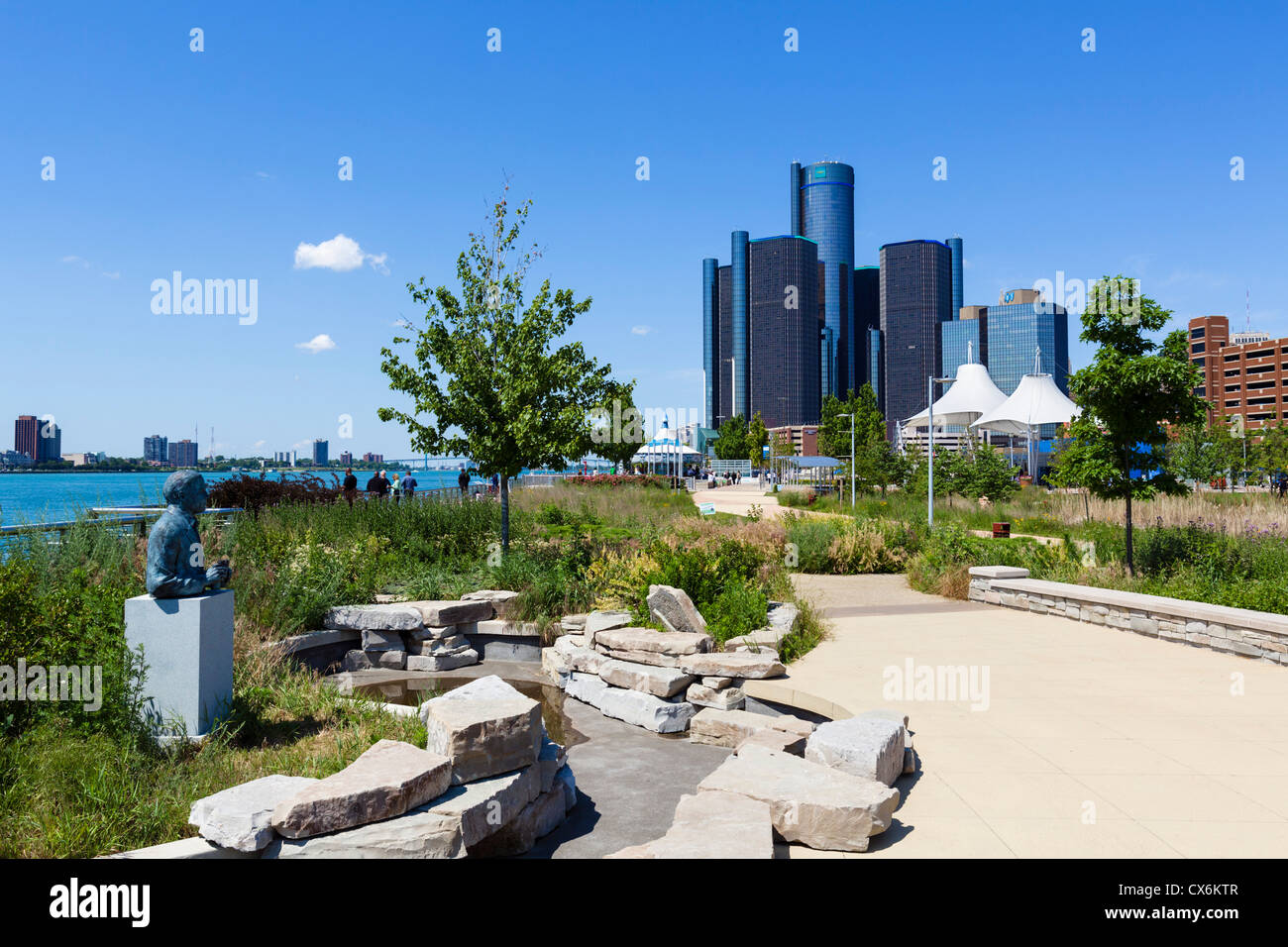 The Renaissance Center city skyline and the Detroit River viewed from Milliken State Park, Detroit, Michigan, USA - Stock Image