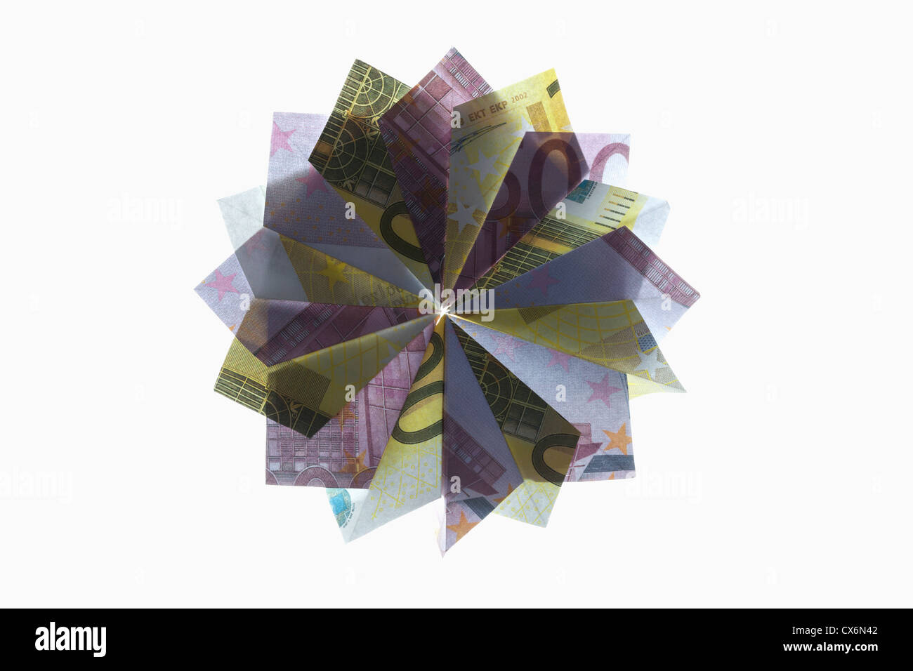 Five hundred Euro bills and two hundred Euro bills folded into a pinwheel shape - Stock Image