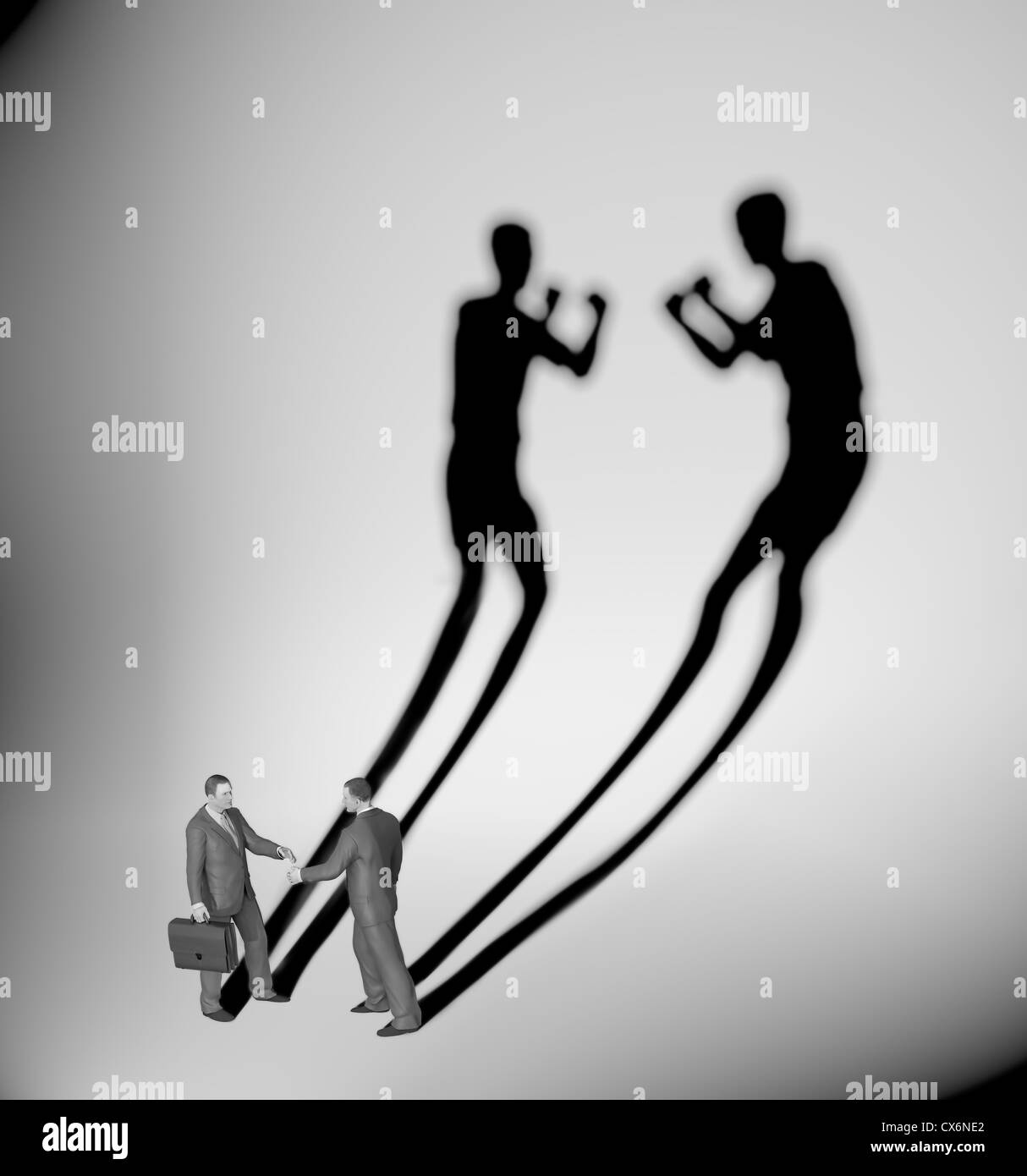 Two businessman casting a shadow shaped like two fighters - Stock Image