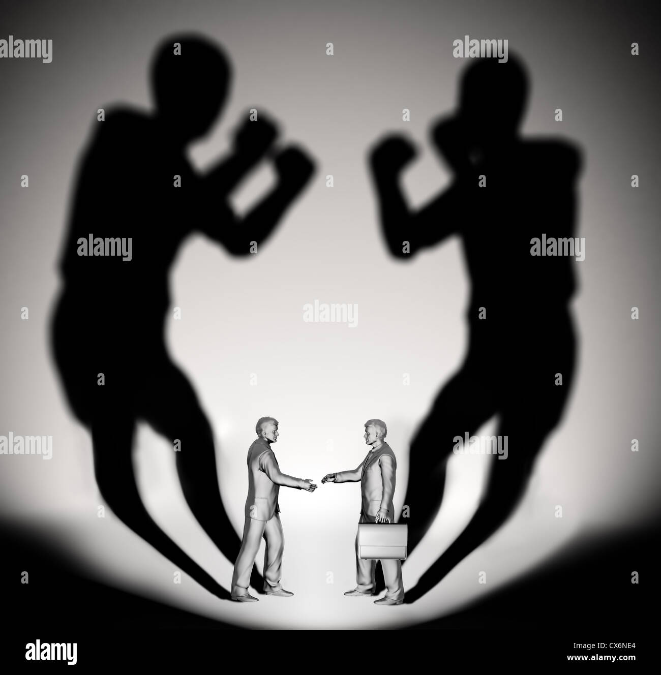 Two businessman casting a shadow shaped like two fighters Stock Photo