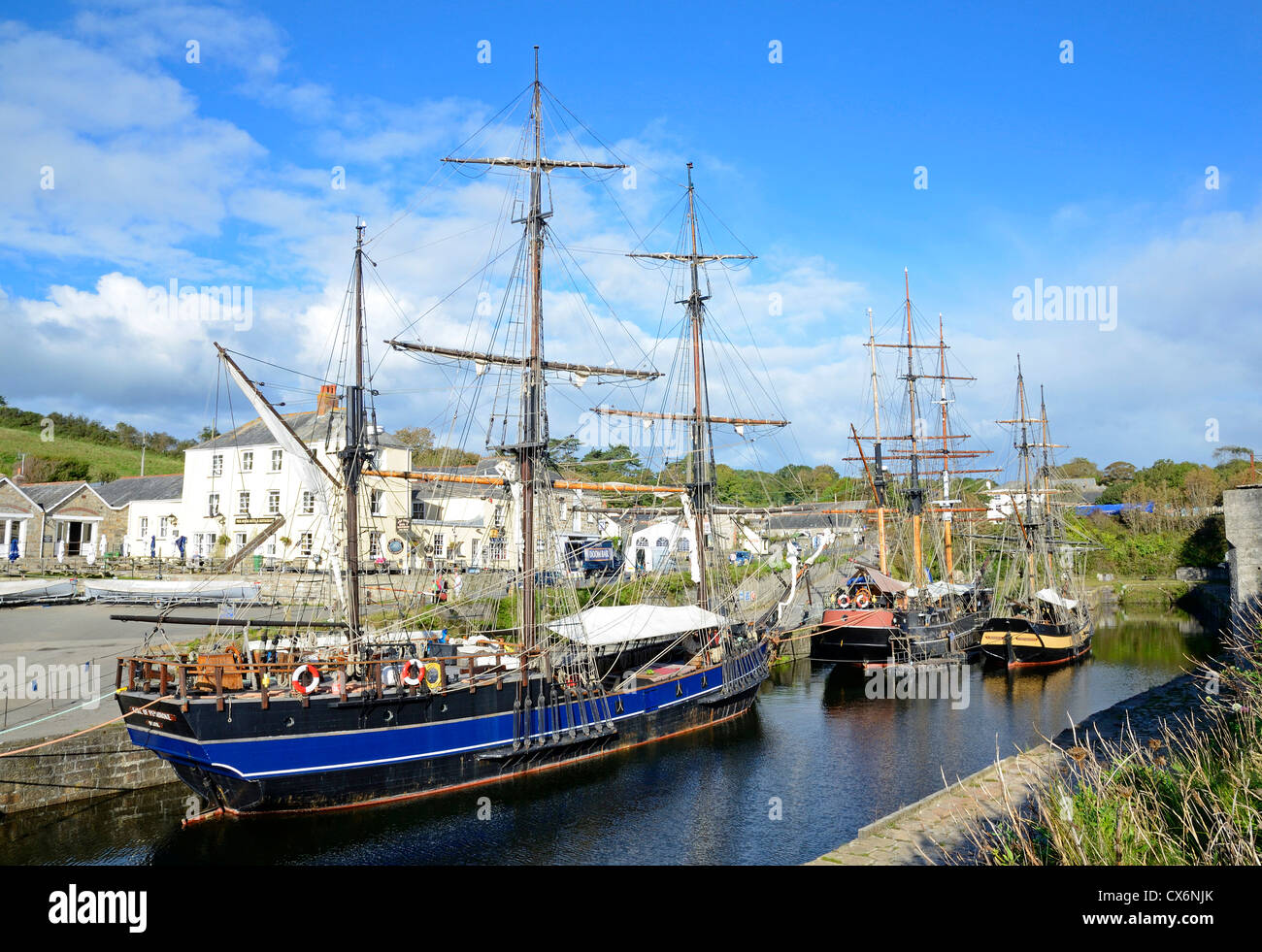 Tall ships in the historic harbour at Charlestown, Cornwall, UK - Stock Image