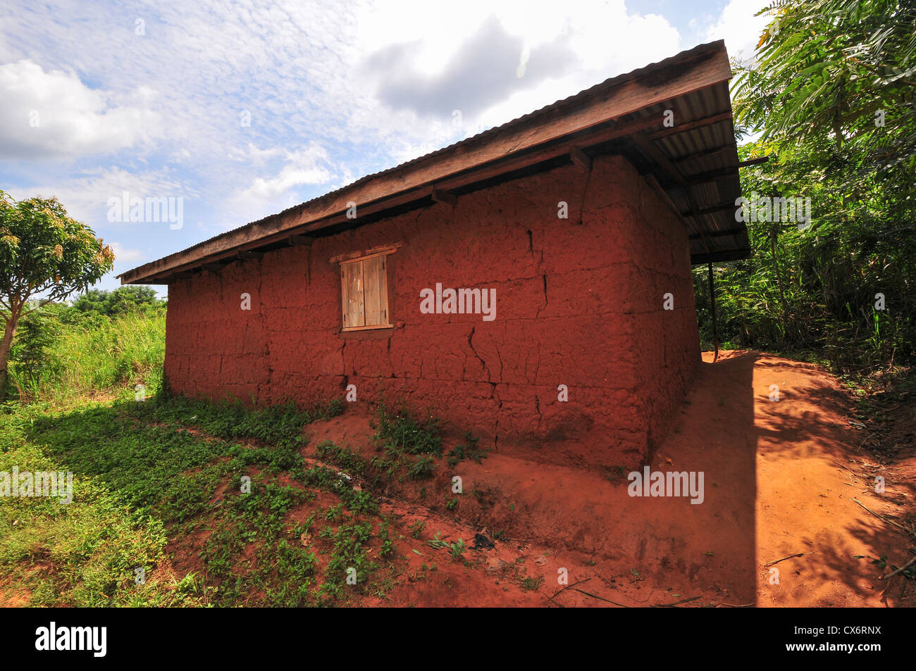 Exterior of an elementary school classroom in the Yilo Krobo District not far from Accra, Ghana. Dirt floor. Mud - Stock Image
