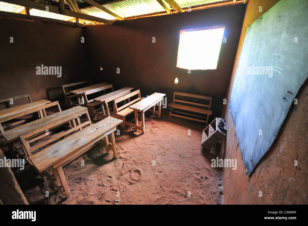Interior of an elementary school classroom in the Yilo Krobo District not far from Accra, Ghana. Dirt floor. Mud - Stock Image