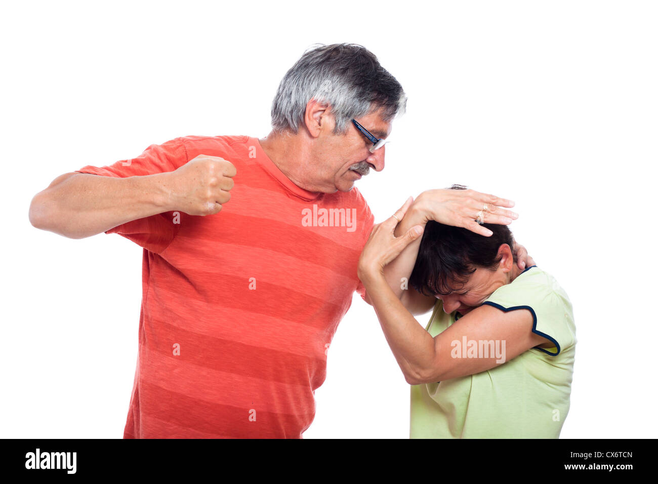 Domestic violence abuse concept, photo of aggressive man and unhappy woman, isolated on white background. - Stock Image