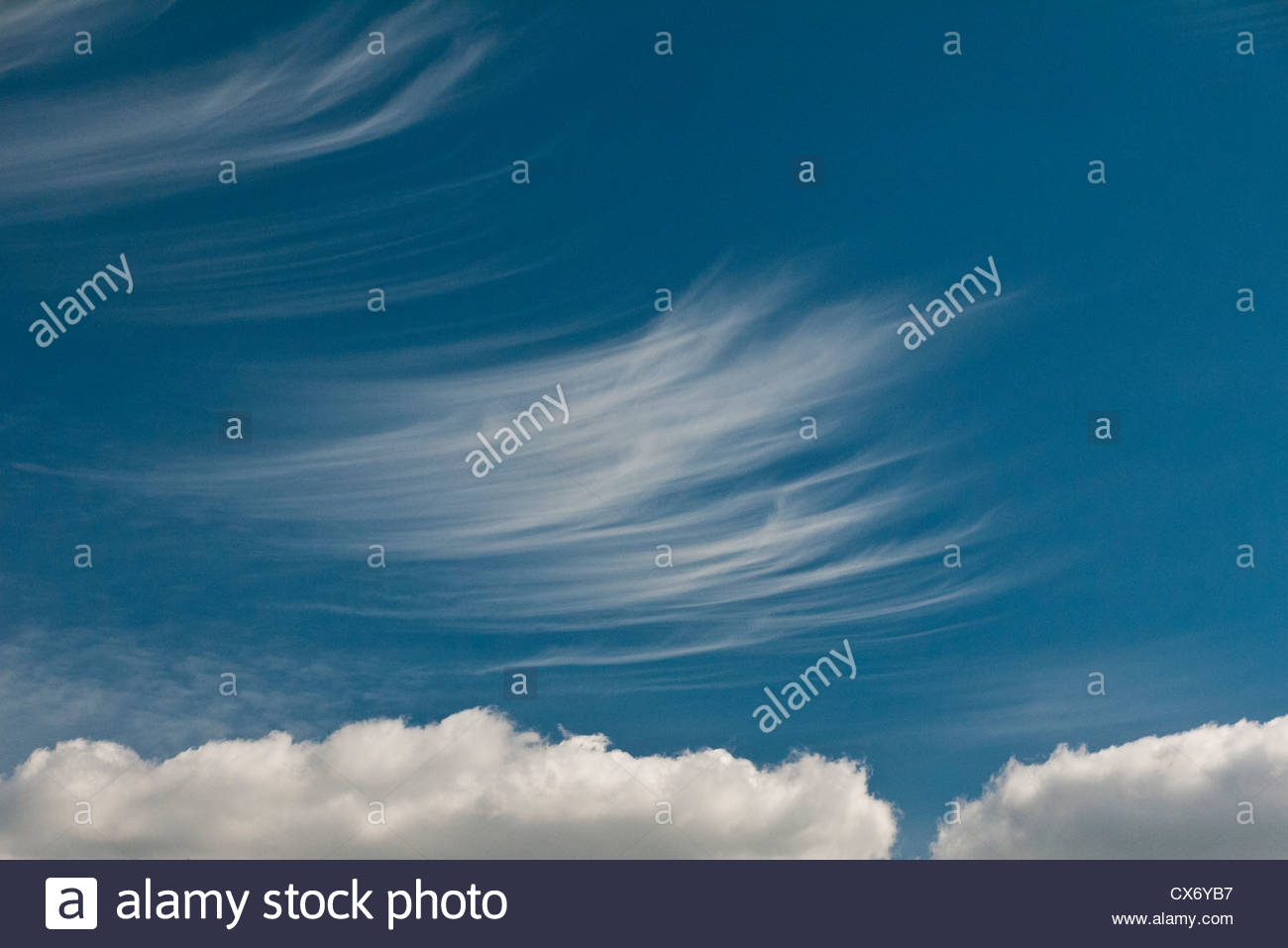 Cirrus clouds above Cumulonimbus Cloud - Stock Image