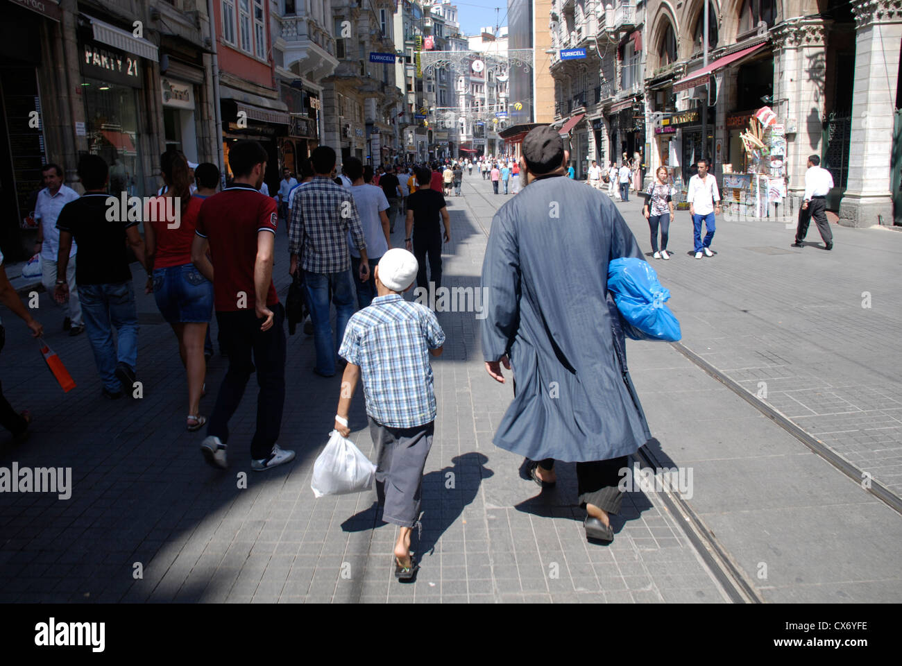A father and son walk together down Istanbul's most famous shopping street Istiklal Caddessi. Picture by Adam - Stock Image