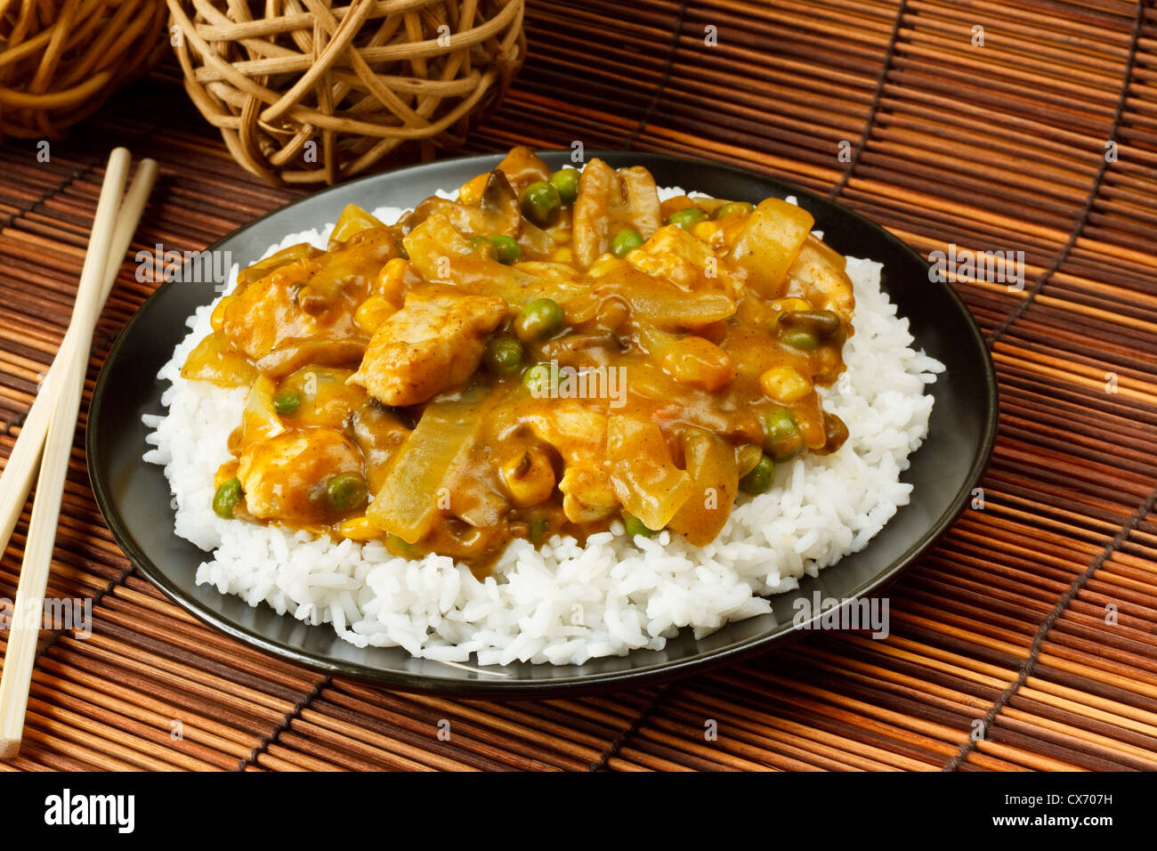 Chicken Curry with boiled rice a popular chinese food available at take aways - Stock Image