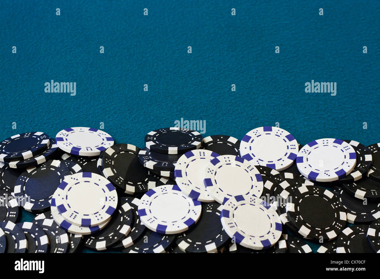 Poker chip frame or border with blue card table velvet - Stock Image