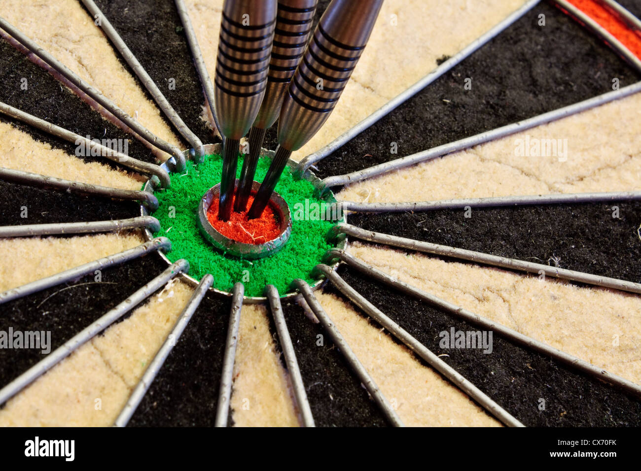 three darts in the bullseye scoring one hundred and fifty in darts