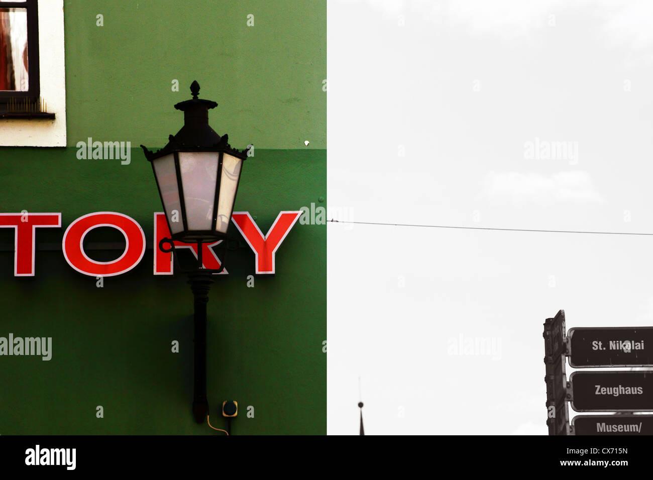 Nostalgic lamp in front of a green house facade Stock Photo