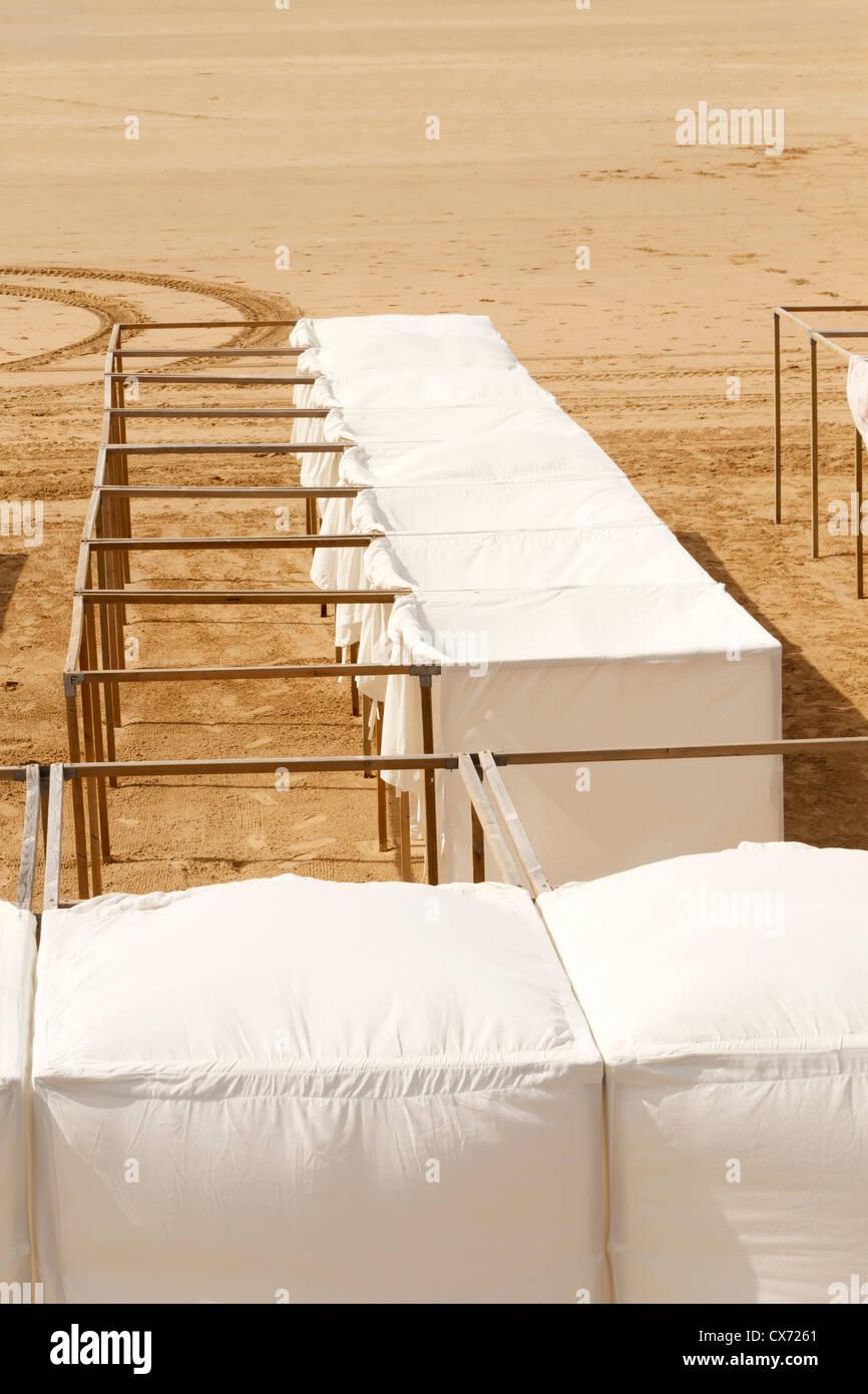 Rows of beach tents on beach of Les Sables-d'Olonne, Vendee, Pays de la Loire, France, Europe. - Stock Image