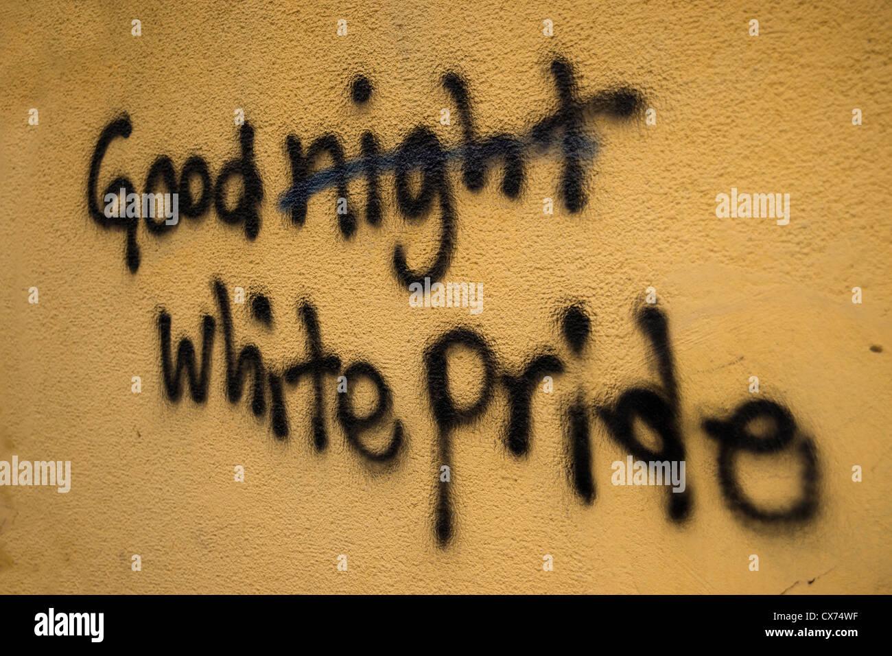 Good night White Pride  graffiti spray painting on yellow wall in Krakow - Stock Image