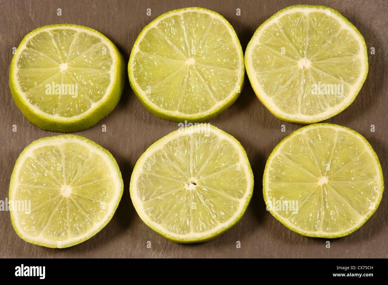 Sliced limes - Stock Image