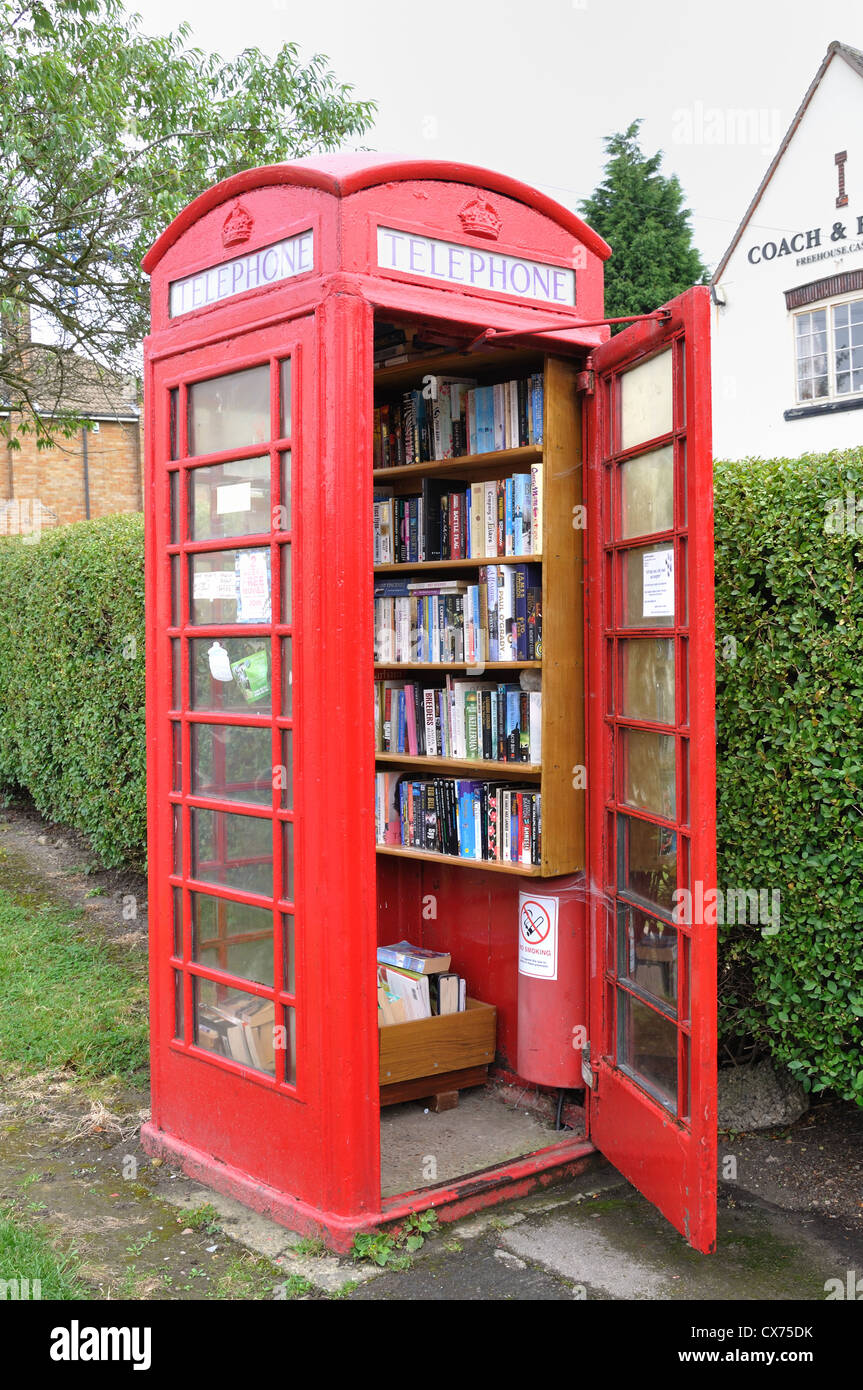 UK red telephone box used as a village library - Stock Image