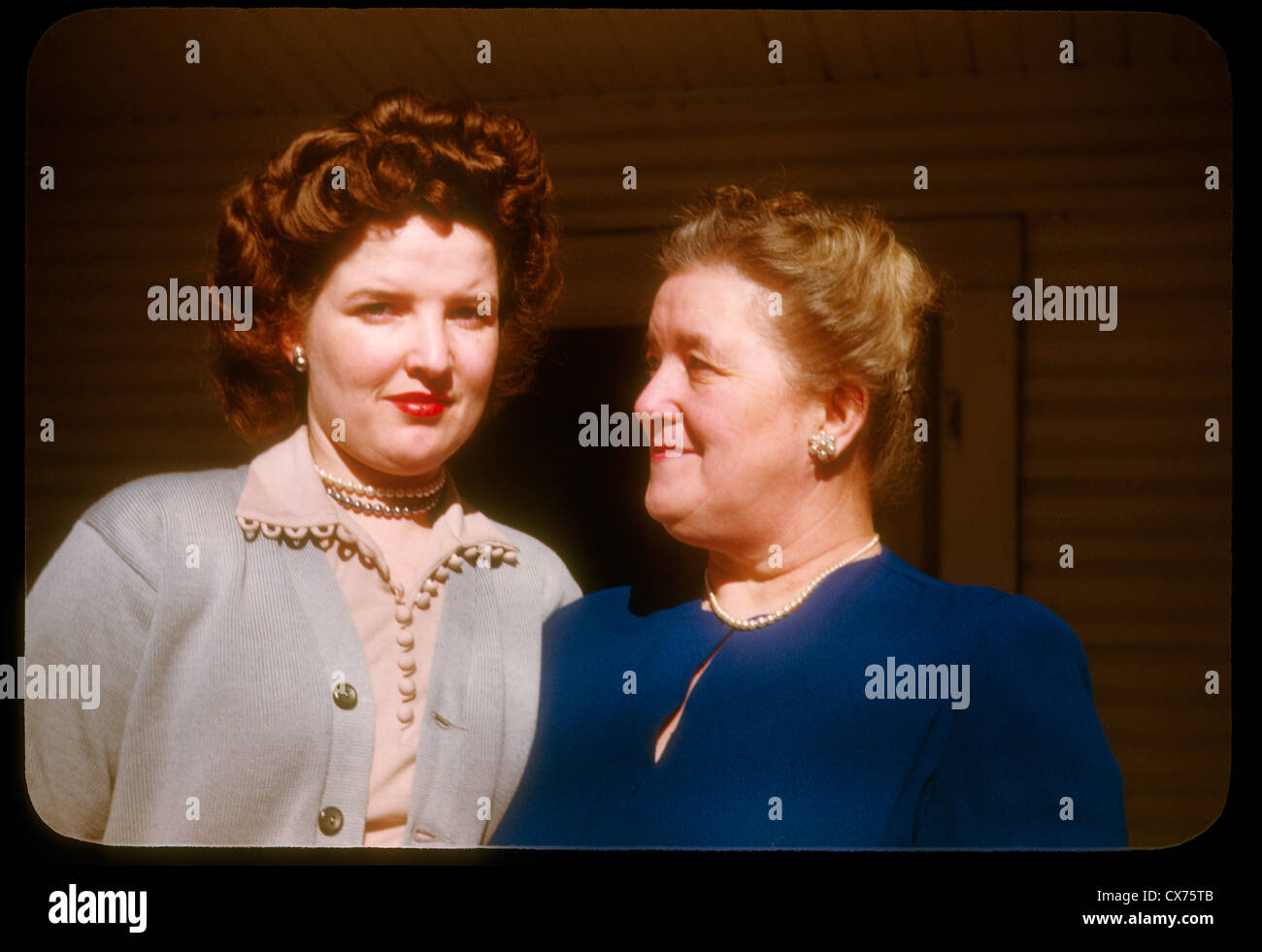 two women mother daughter portrait kodachrome color 1940s indiana fashion hair styles white redheads two Stock Photo