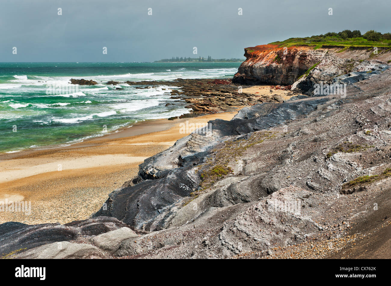 Rugged Red Cliff at Yuraygir National Park. - Stock Image