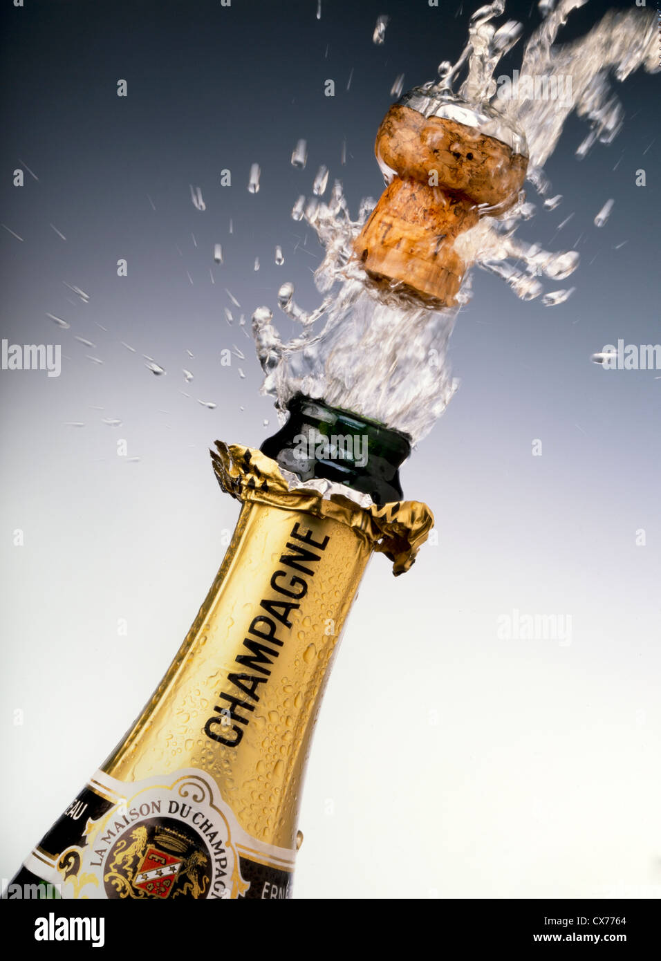 CHAMPAGNE BOTTLE WITH CORK POPPING - Stock Image