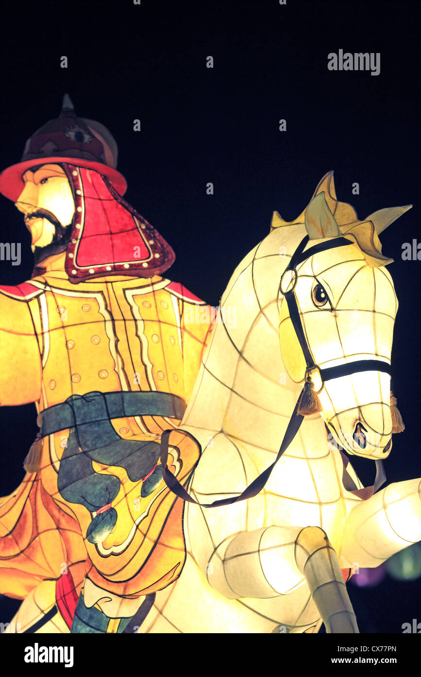 Illuminated sculptures of ancient Korean warriors on display in Chinatown, Singapore - Stock Image
