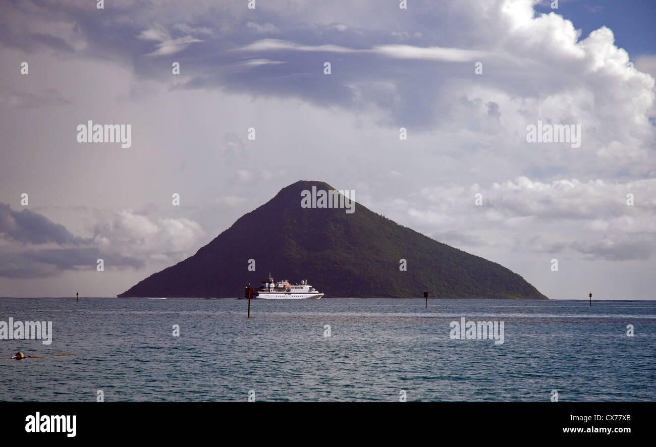 Cruise liner anchored in front of Tafahi volcanic island, Tonga. - Stock Image