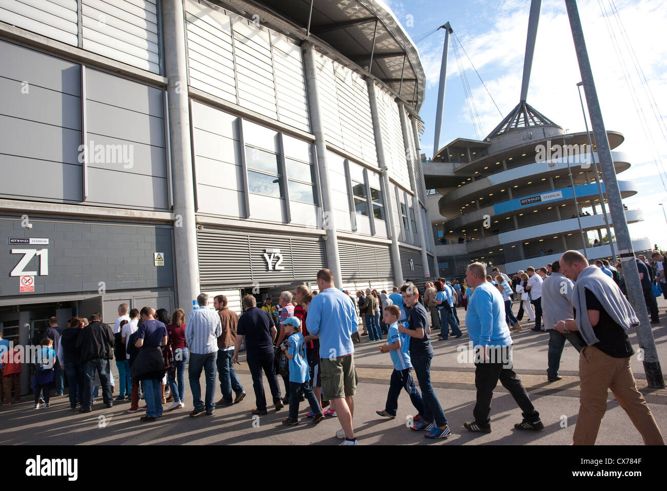 Fans queue outside the Etihad Stadium, Manchester City Football Club, Manchester, England, United Kingdom - Stock Image