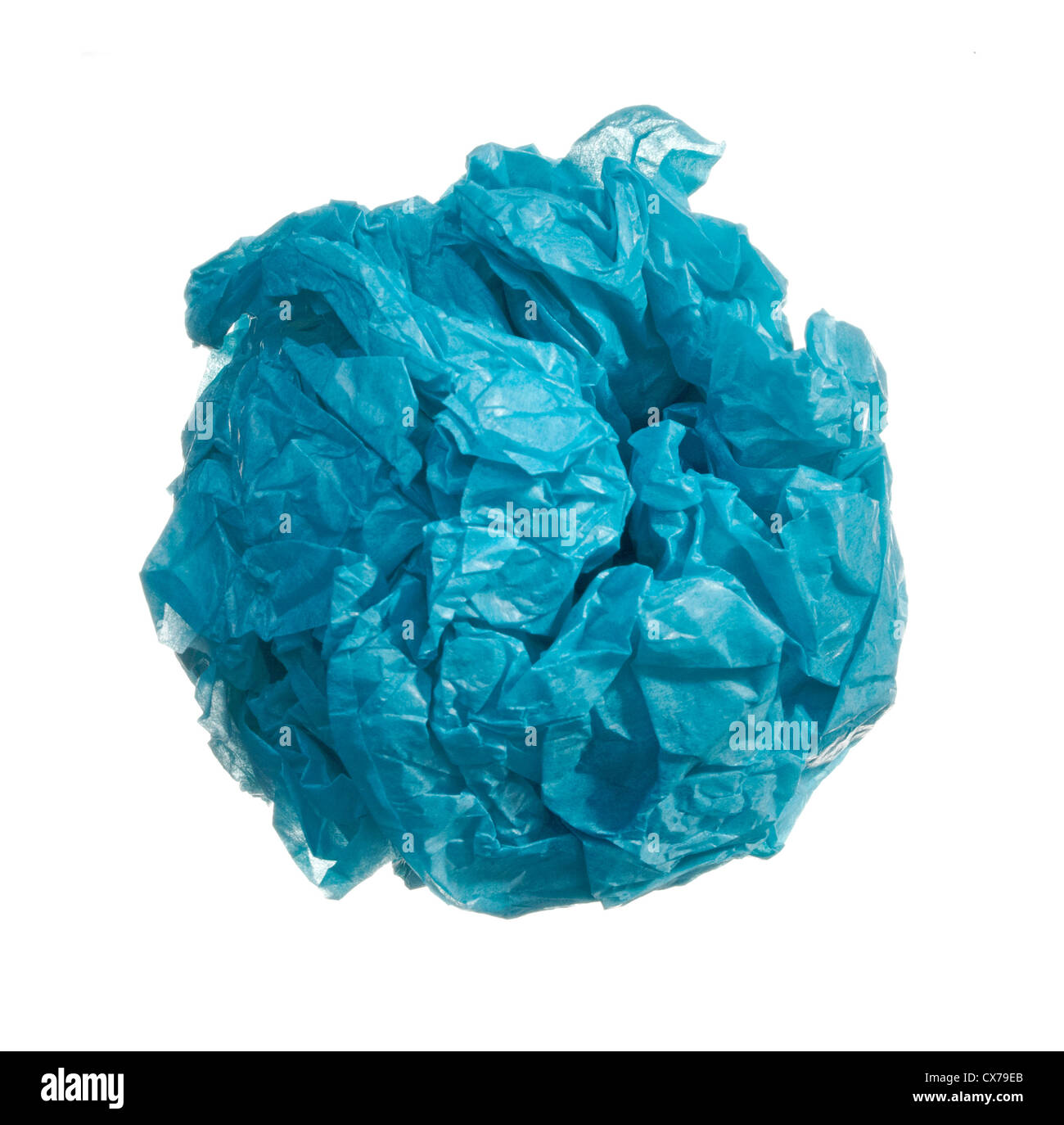 blue wad of paper in a ball shape photographed on a white background - Stock Image