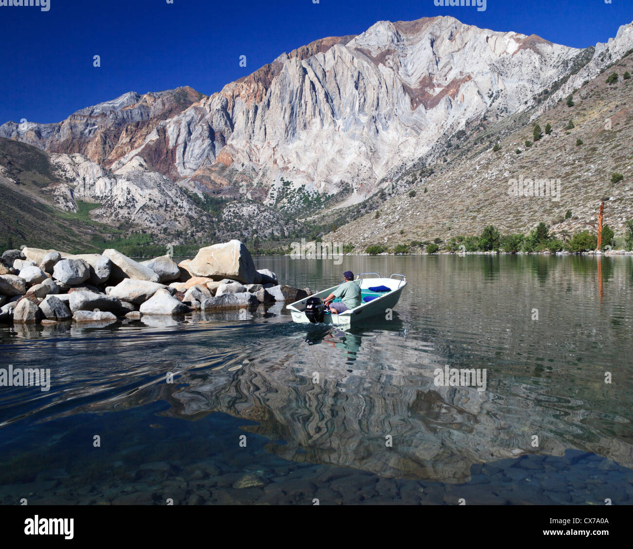fisherman in boat at convict lake in northern california near