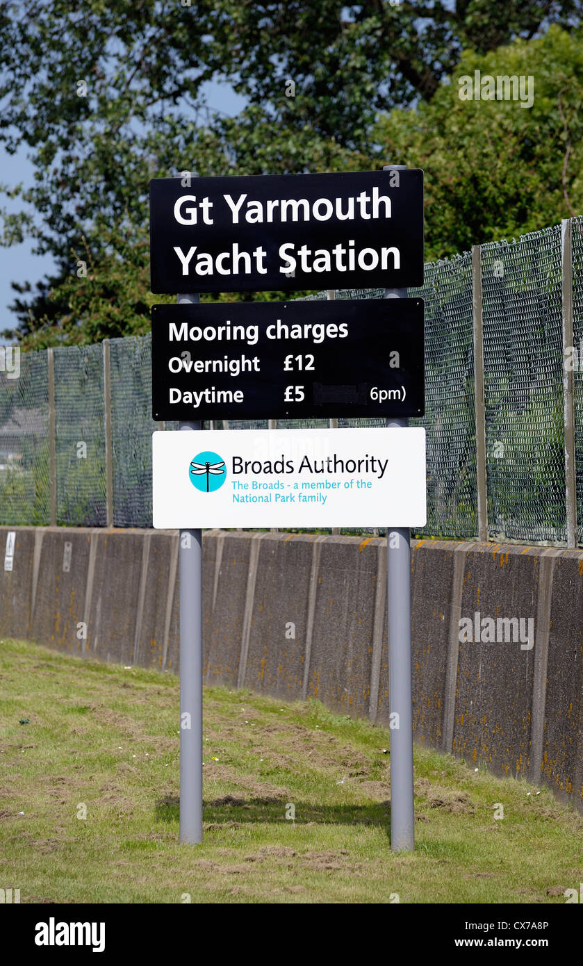 great yarmouth yacht station mooring charges sign norfolk england uk - Stock Image