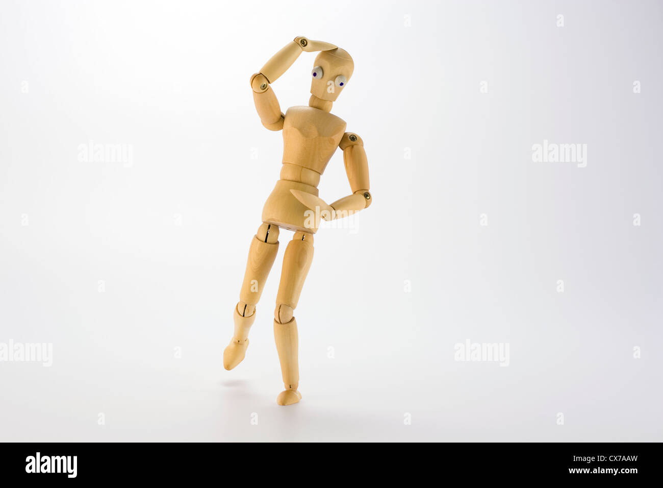 Figure with hand on head (Confused, thinking?) Looking down at hand, (Map reading, text message?) - Stock Image