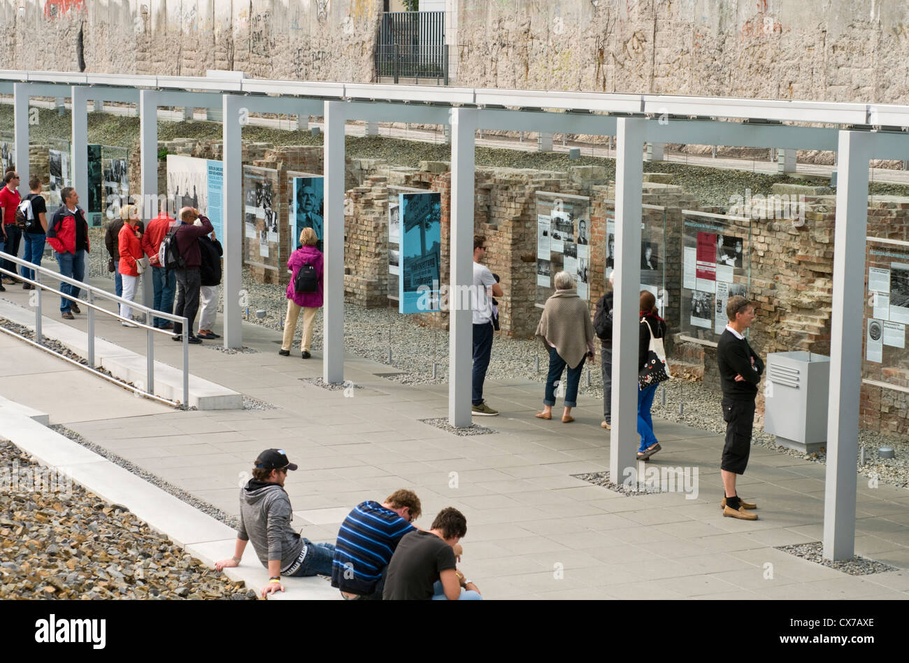 Tourists at the Topography of Terror outdoor museum in Berlin, Germany, which includes a preserved section of the - Stock Image