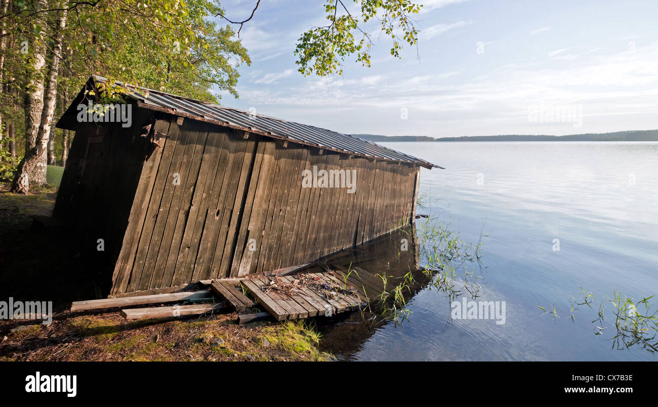 Small old wooden boat garage on the coast of Saimaa lake, typically construction for Finland Stock Photo