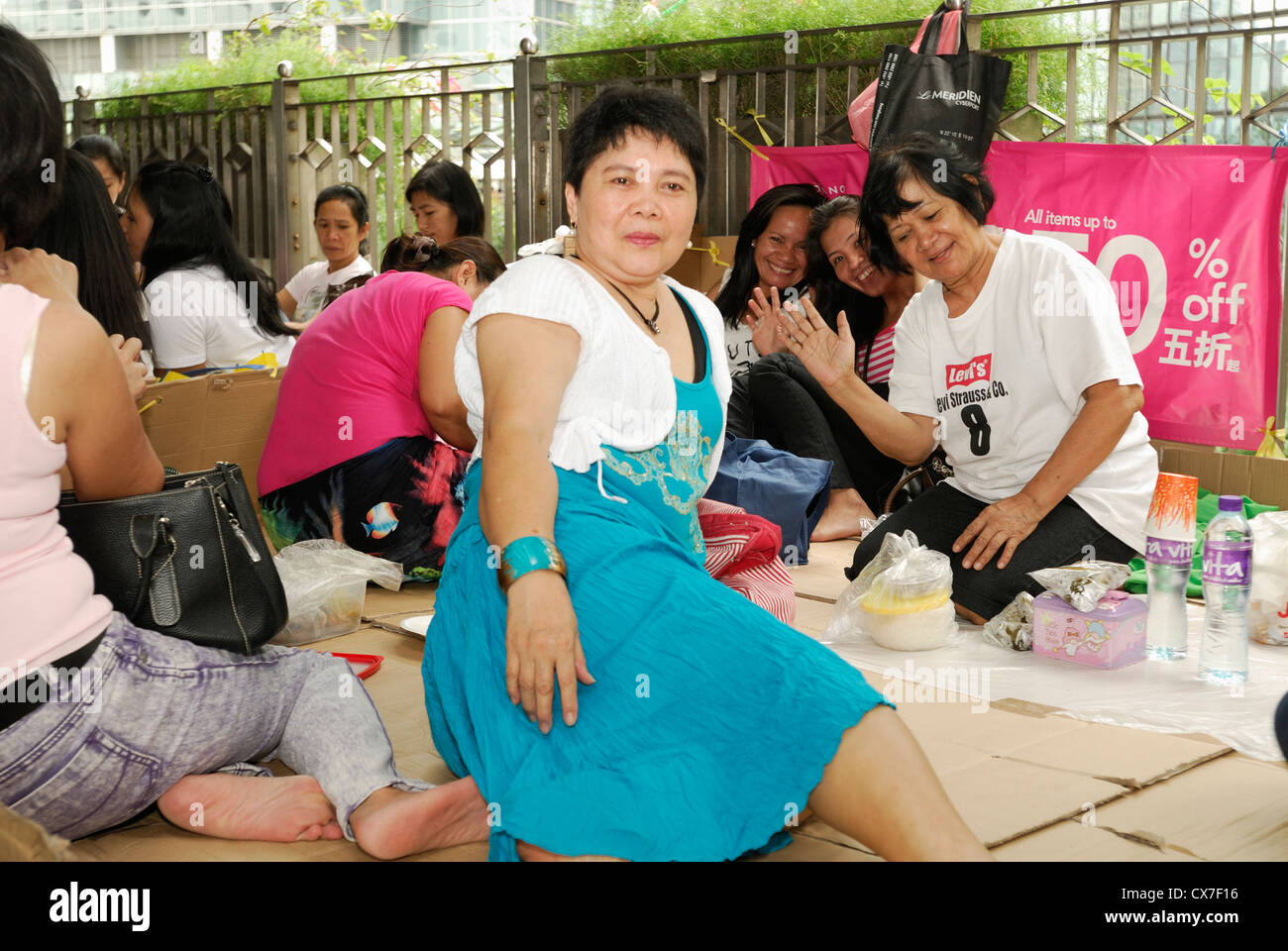 Filipino Nannies congregate on the streets of Hong Kong on Sundays. - Stock Image