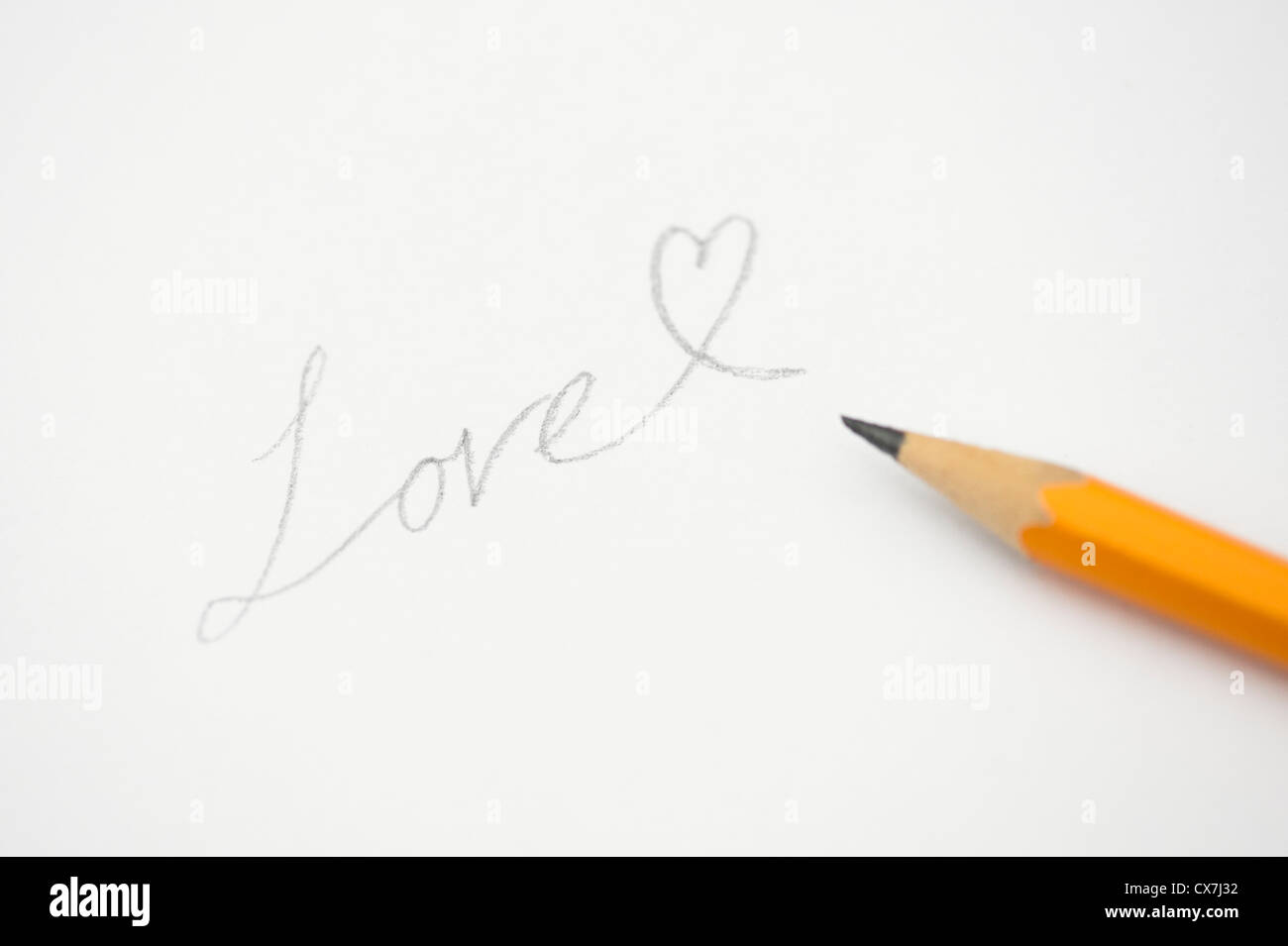Love heart pencil on white background - Stock Image