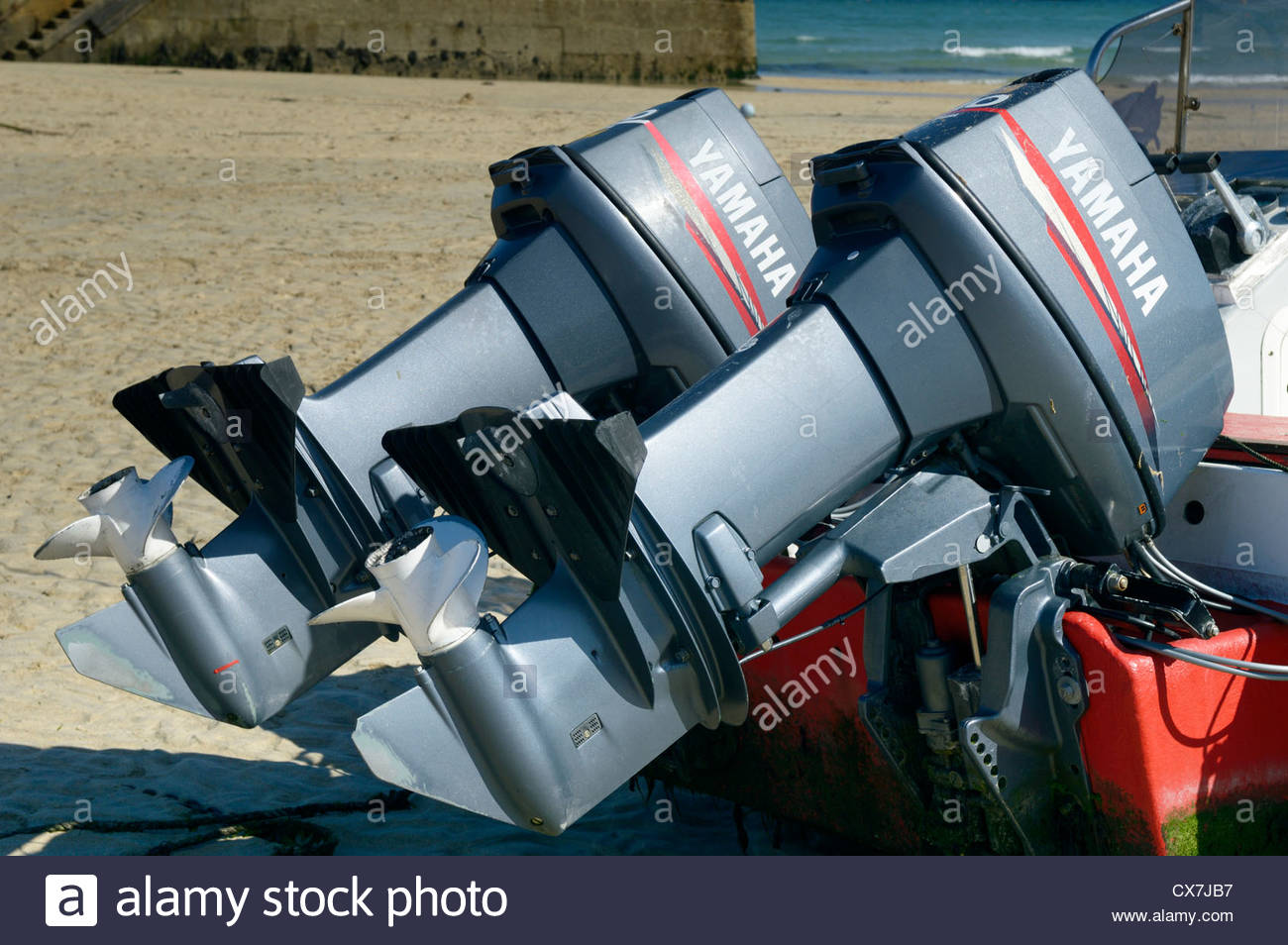 Yamaha boat motors on the beach in St Ives Harbour, Cornwall, England1 Stock Photo