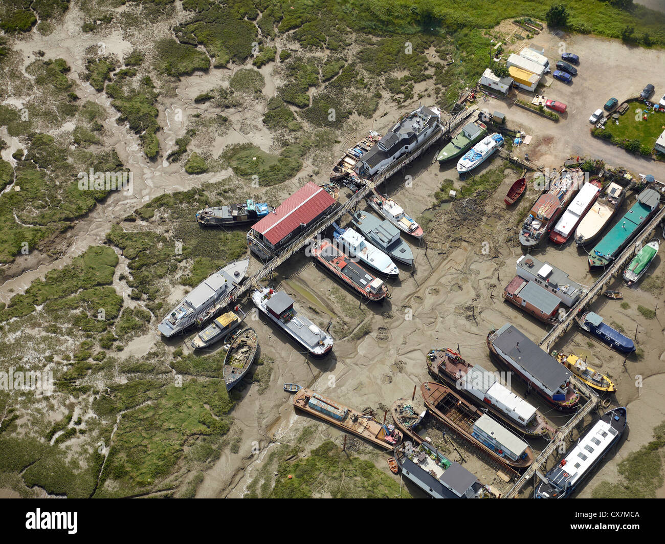 House boats at low tide on the  river Medway, Strood, Chatham, Kent, south east England - Stock Image