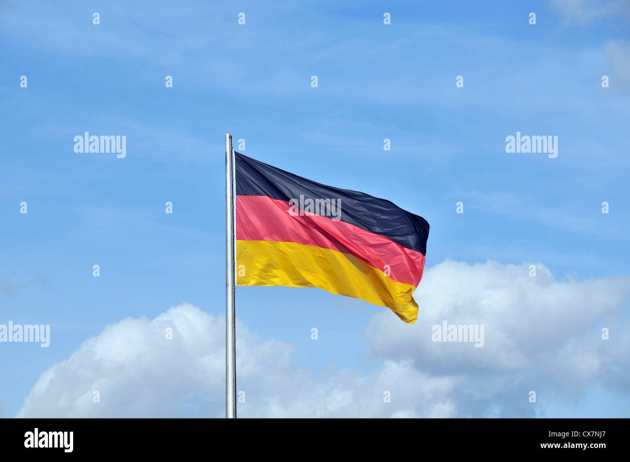 germany flag in blue sky - Stock Image