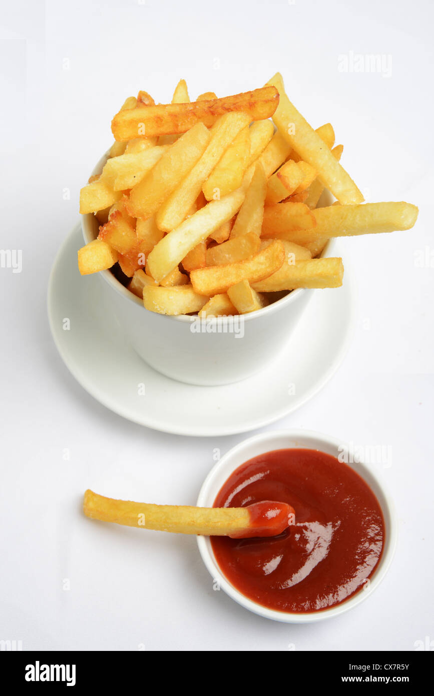 french fries and ketchup on white background - Stock Image