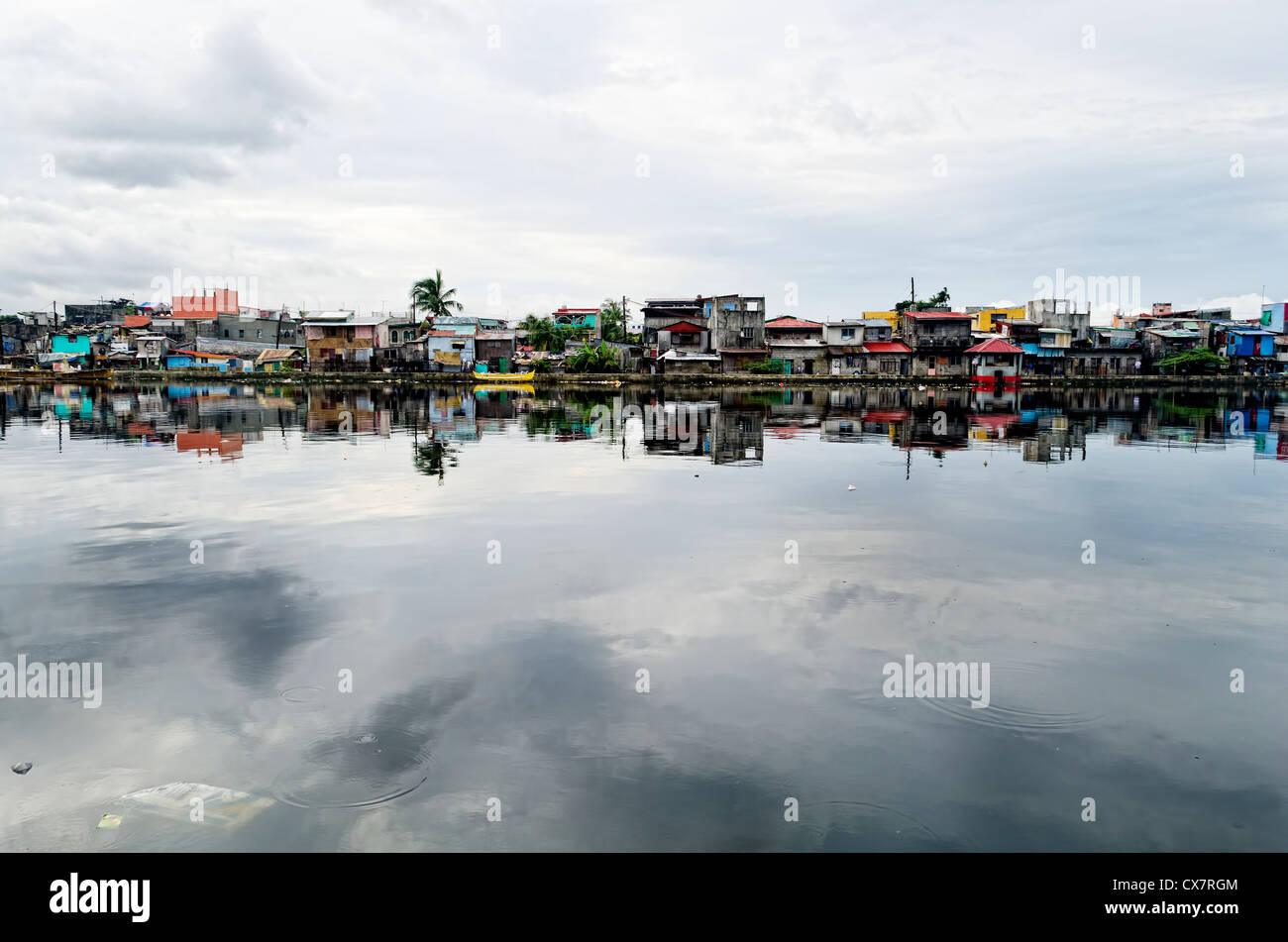 Rows of houses along the Malabon River in Metro Manila, Philippines - Stock Image
