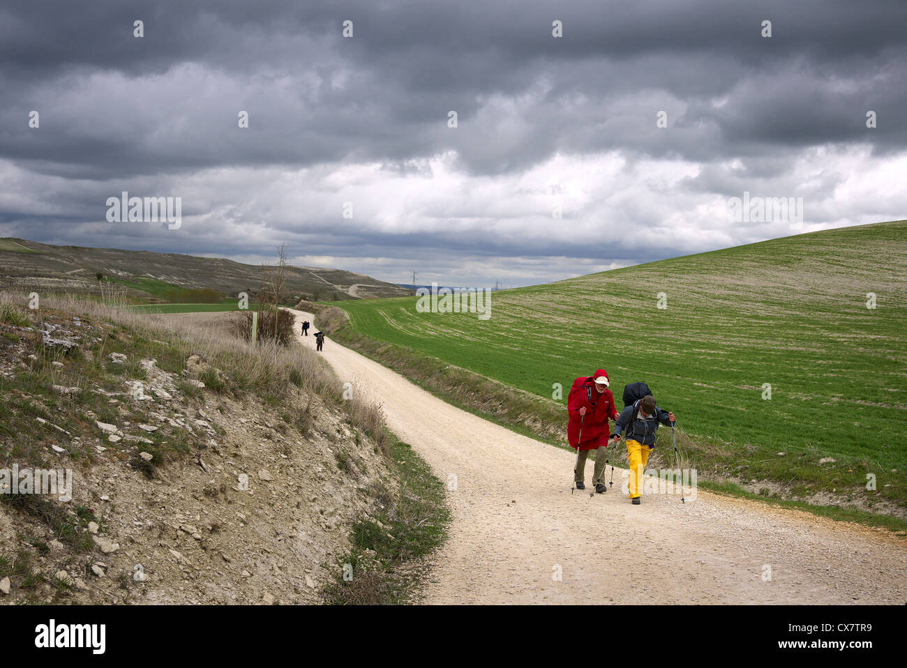 Pilgrims walking the camino to Santiago in Castilla y Leon, Spain. - Stock Image