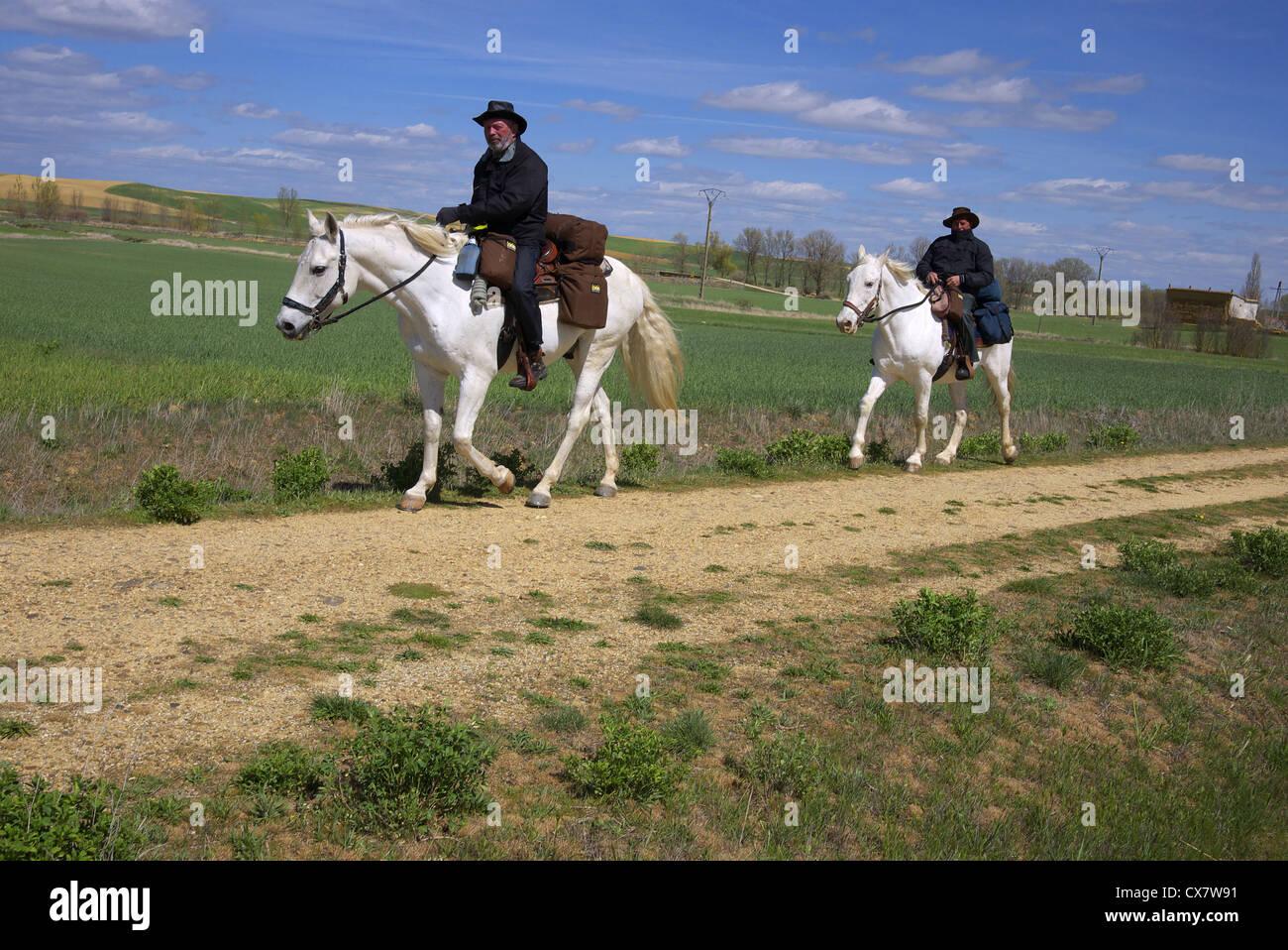 Two pilgrims on horseback en route to Santiago de Compostela, near Fromista, Spain. - Stock Image