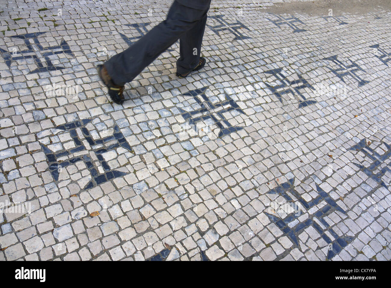 The cross of the Knights Templar in the pavement in Tomar, Portugal. - Stock Image