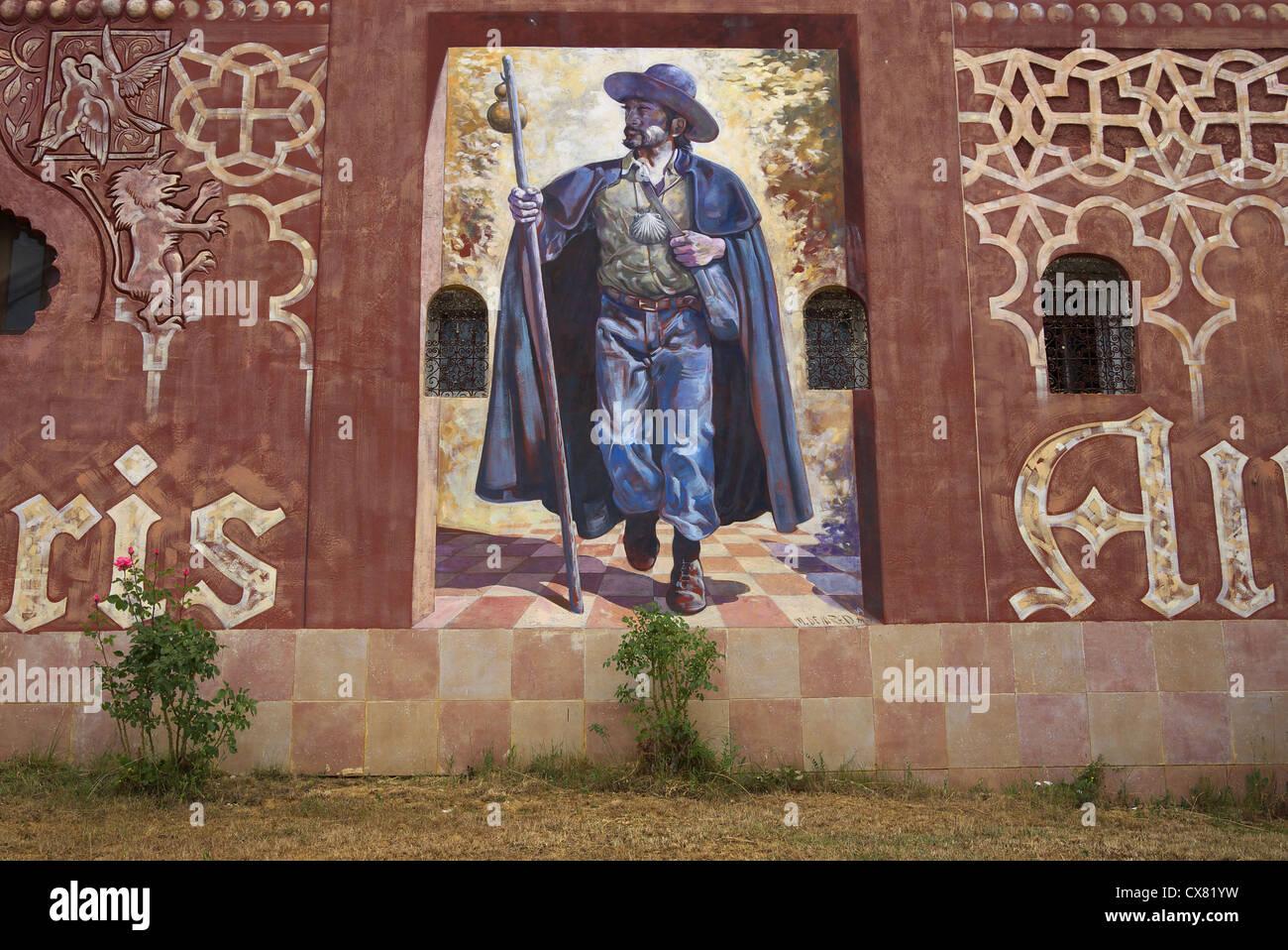 Mural of a pilgrim on the road to Santiago at the albergue Viatoris in Sahagun, Spain. - Stock Image