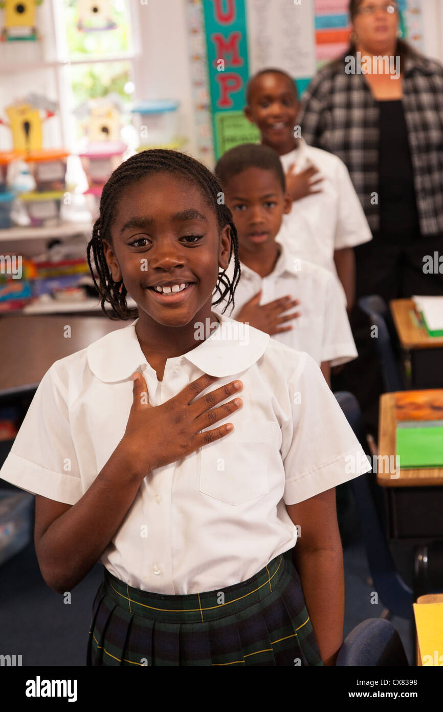 Bahamian school children pledge allegiance to the flag in New Plymouth on Green Turtle Cay, Bahamas. - Stock Image