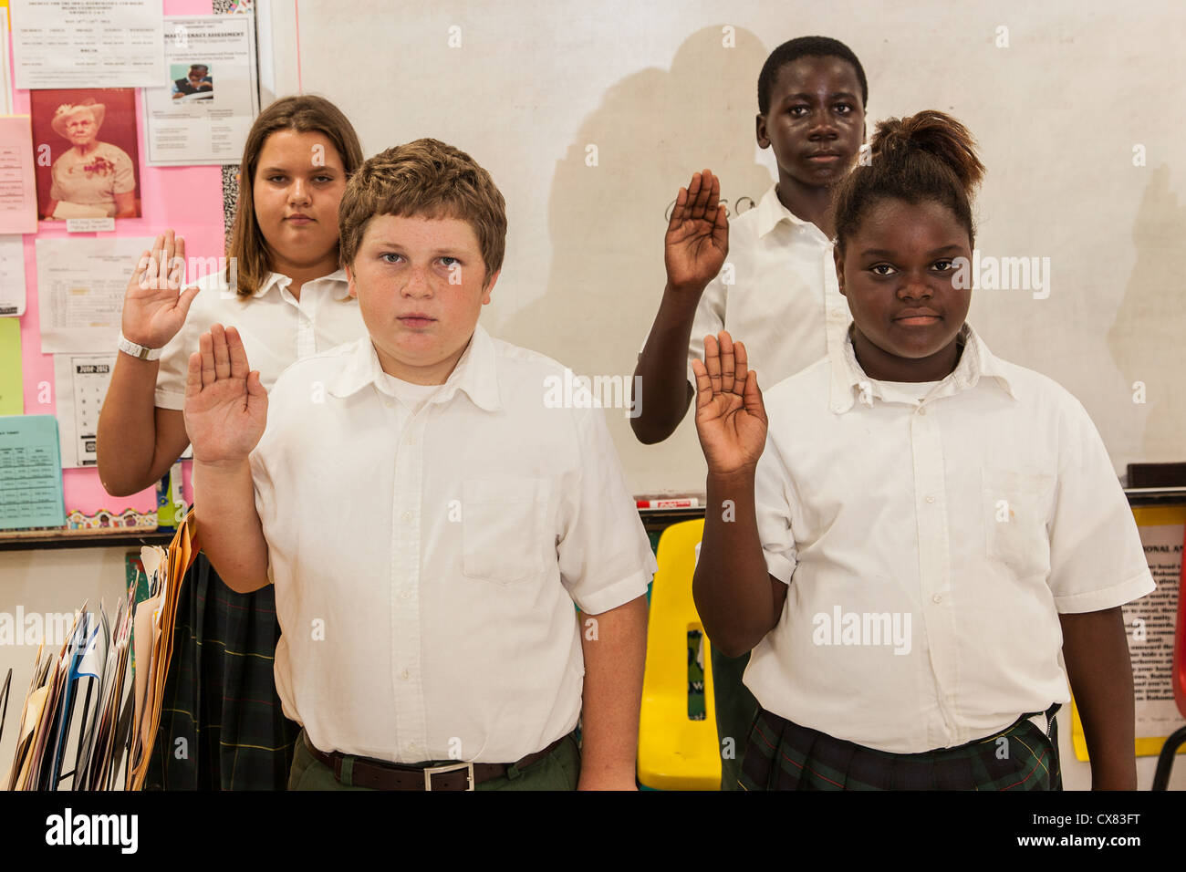 Bahamian school children practice the graduation oath in New Plymouth on Green Turtle Cay, Bahamas. - Stock Image