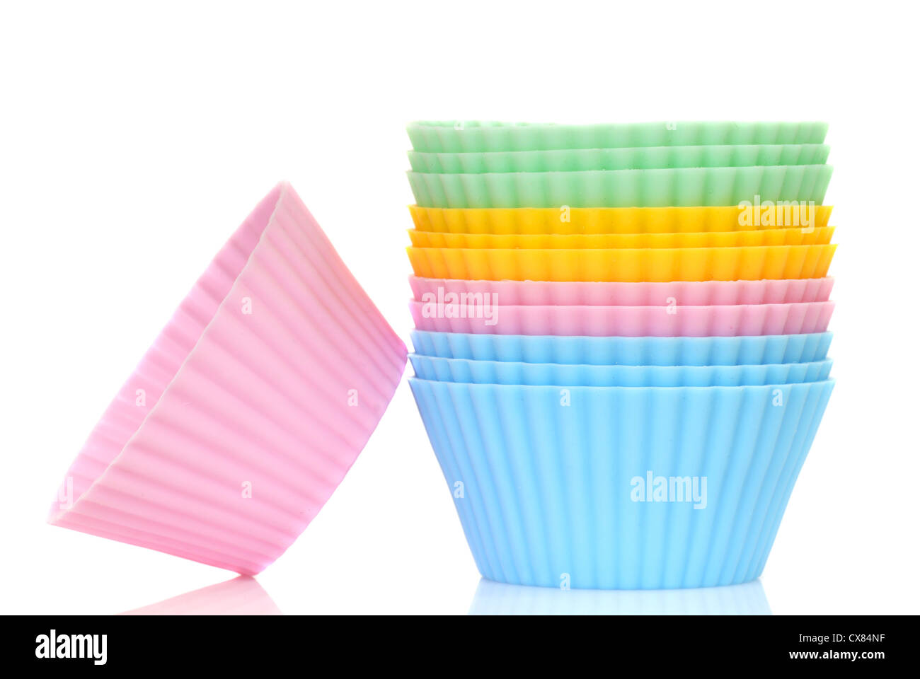Stack of a variety of colorful cupcake liners in pastel colors - Stock Image