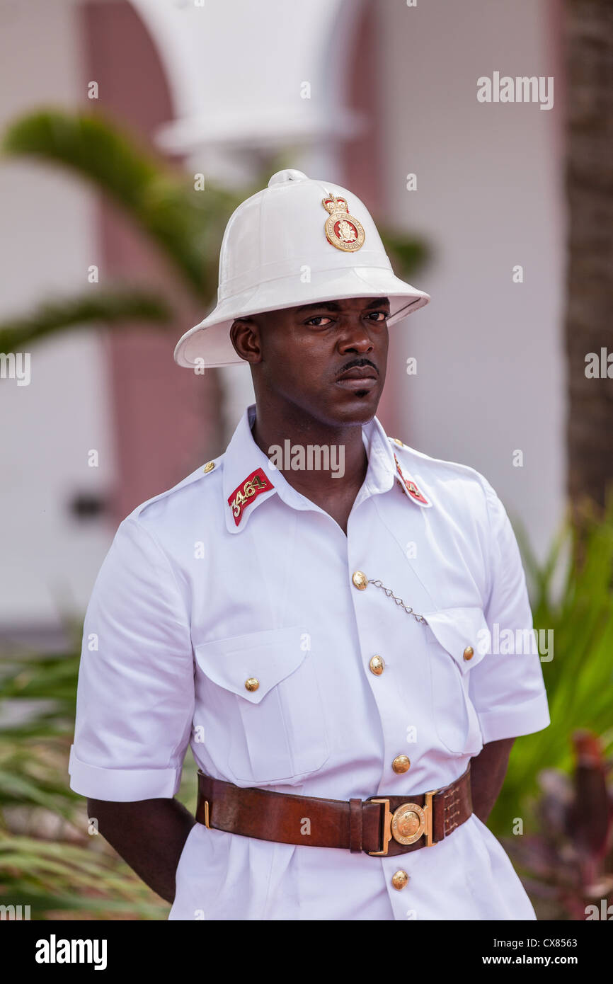 3a592b9485b0e A member of the Royal Bahamas Police wearing a Wolseley pith helmet patrols  Parliament Square Nassau