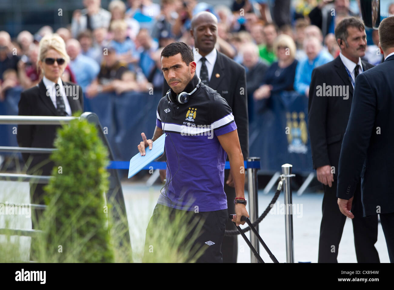 Carlos Tevez footballer arriving at the Etihad Stadium, Manchester City Football Club, Manchester, England, United - Stock Image
